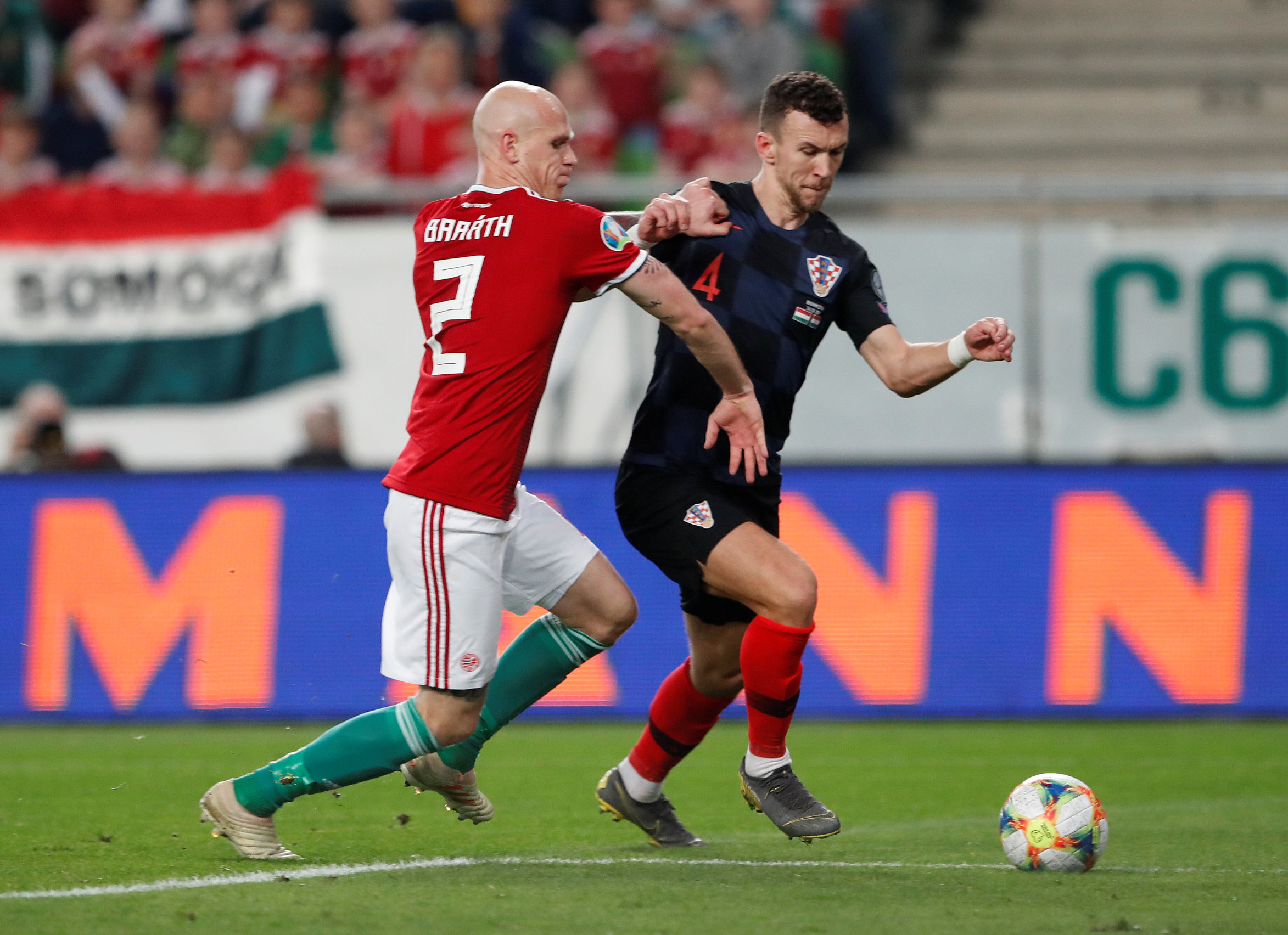 Soccer Football - Euro 2020 Qualifier - Group E - Hungary v Croatia - Groupama Arena, Budapest, Hungary - March 24, 2019  Croatia's Ivan Perisic in action with Hungary's Botond Barath   REUTERS/Bernadett Szabo