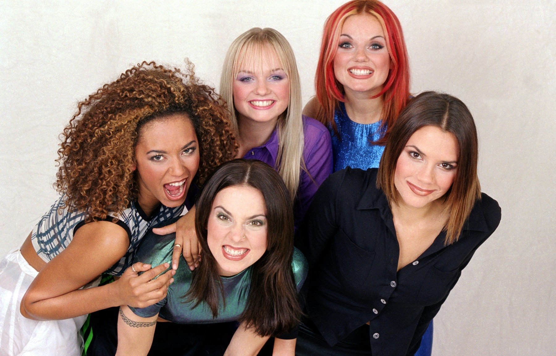 British all girl pop group The Spice Girls pose for a group photograph in the Daily Mirror Studios. They are back ro left to right: Mel B (Scary Spice), Emma Bunton (Baby Spice), Geri Halliwell (Ginger Spice) and  Victoria Adams (Posh Spice). Front is Melanie Chisholm (Sporty Spice). 23rd October 1996., Image: 175232832, License: Rights-managed, Restrictions: , Model Release: no, Credit line: Profimedia, MirrorPix