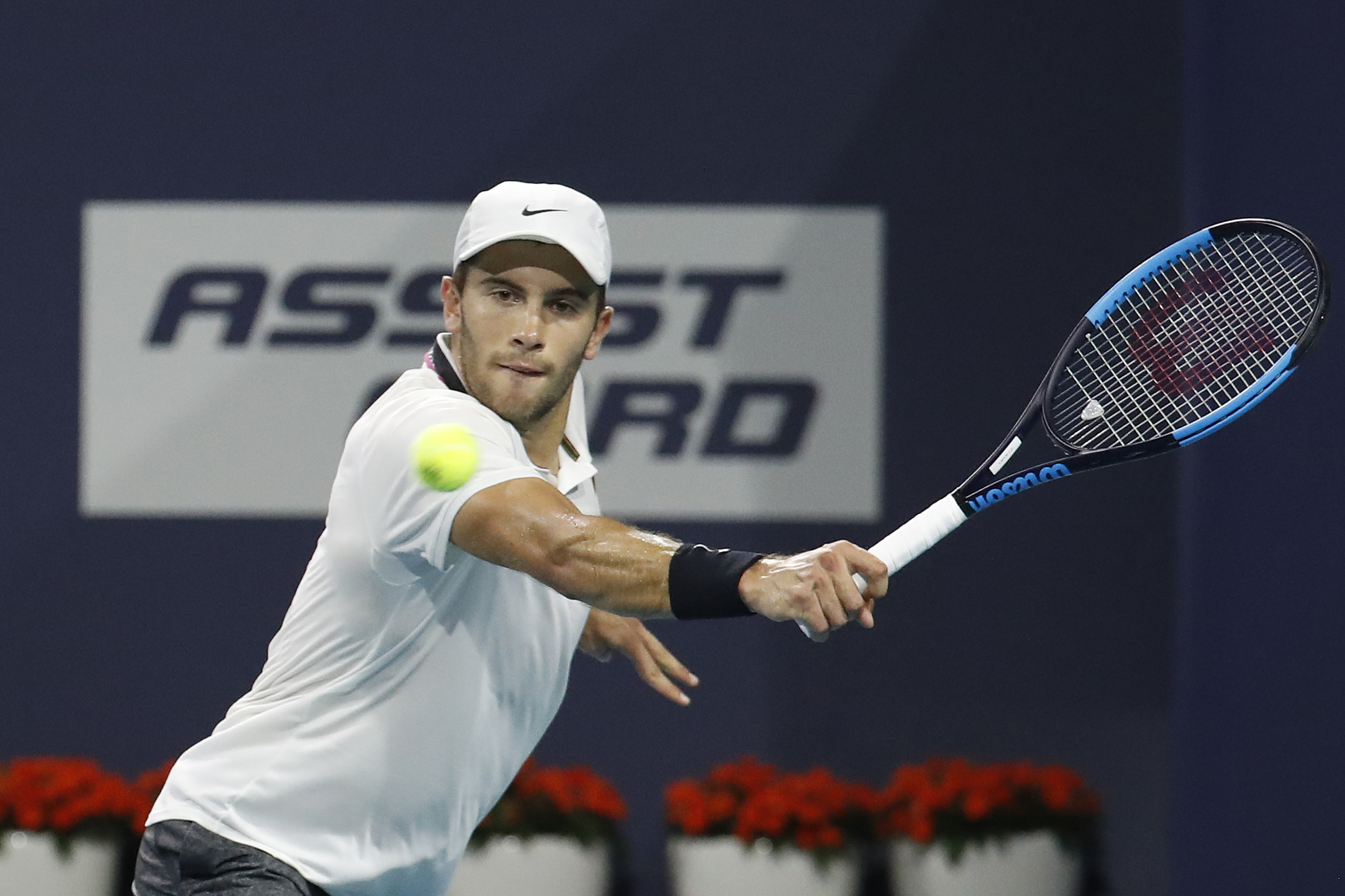 Mar 27, 2019; Miami Gardens, FL, USA; Borna Coric of Croatia hits a backhand against Felix Auger-Aliassime of Canada (not pictured) in a mens quarterfinal of the Miami Open at Miami Open Tennis Complex. Mandatory Credit: Geoff Burke-USA TODAY Sports - 12425379