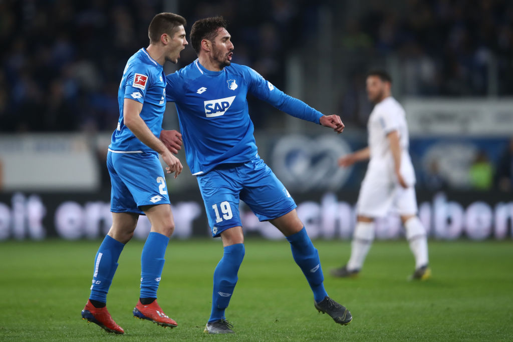 SINSHEIM, GERMANY - MARCH 29: Ishak Belfodil of Hoffenheim celebrates his team's first goal with team mate Andrej Kramaric during the Bundesliga match between TSG 1899 Hoffenheim and Bayer 04 Leverkusen at PreZero-Arena on March 29, 2019 in Sinsheim, Germany. (Photo by Alex Grimm/Bongarts/Getty Images)