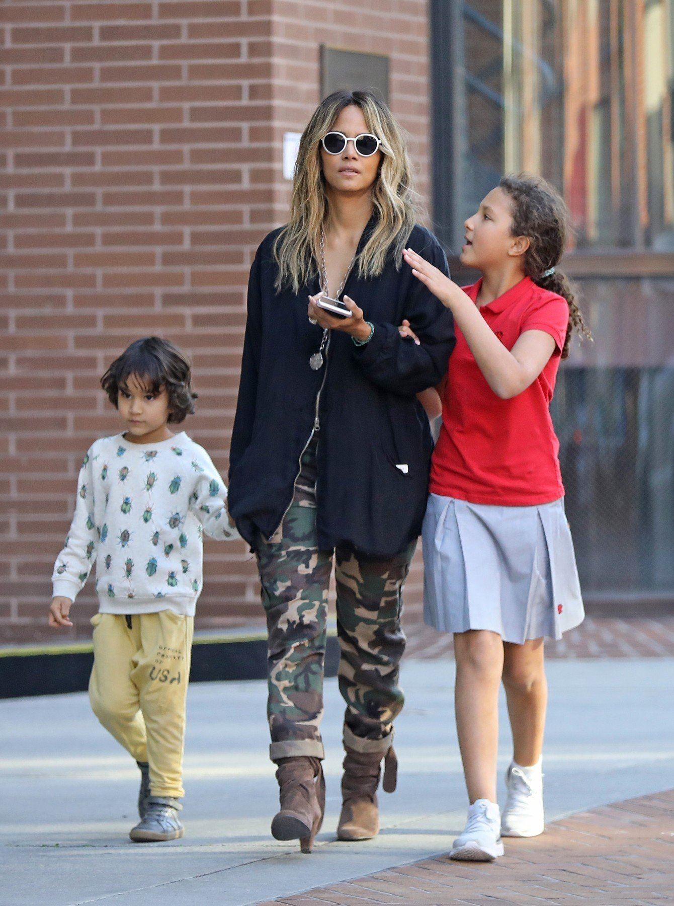 Beverly Hills, CA  - *EXCLUSIVE* Halle Berry takes her kids Nahla and Maceo shopping in Beverly Hills. The threesome walk arm in arm enjoying each others company during their family outing.  Pictured: Halle Berry    *UK Clients - Pictures Containing Children Please Pixelate Face Prior To Publication*, Image: 417299699, License: Rights-managed, Restrictions: , Model Release: no, Credit line: Profimedia, Backgrid USA