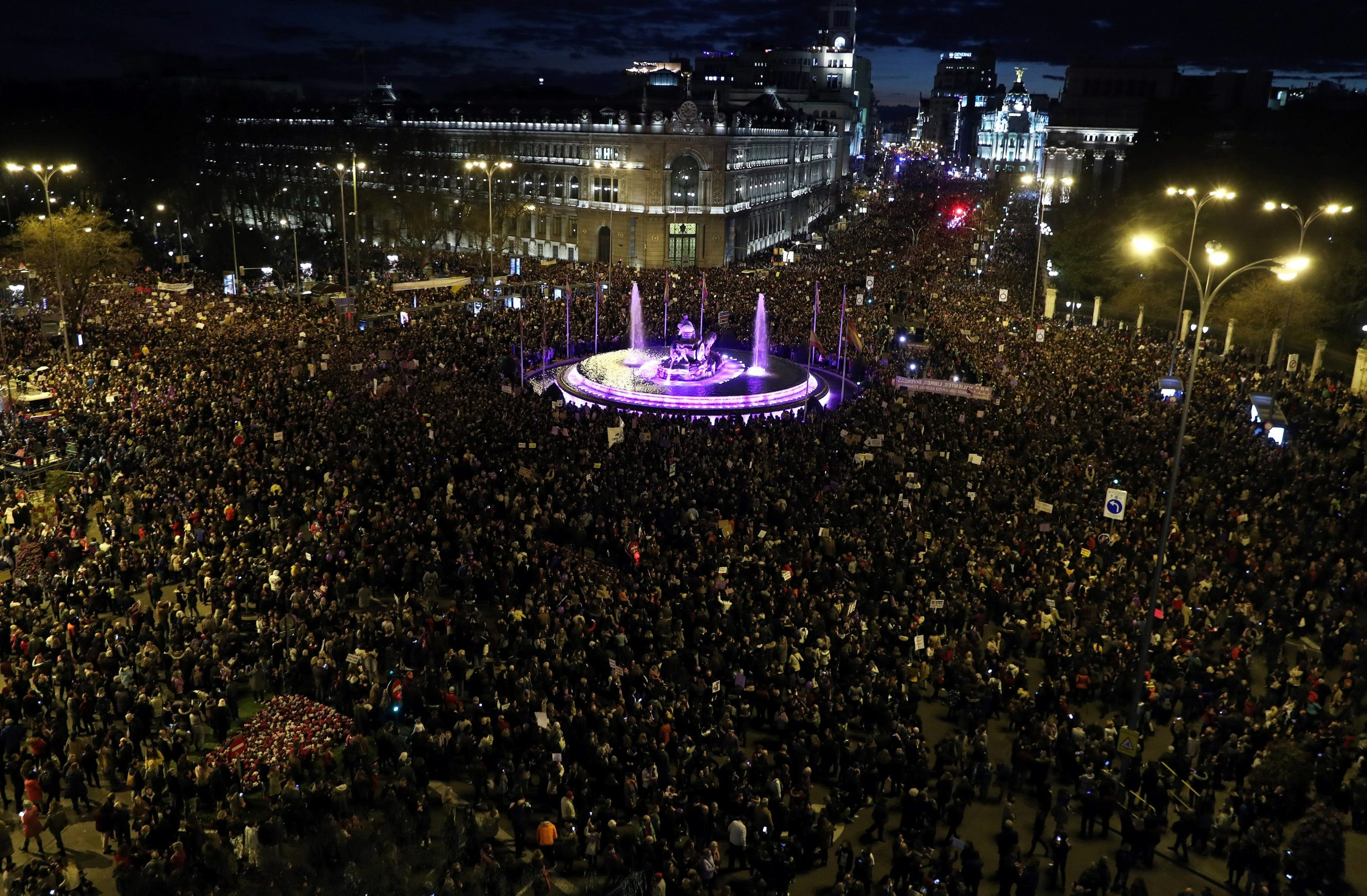 The Cibeles fountain is lit as people take part in a demonstration during a nationwide feminist strike on International Women's Day in Madrid, Spain, March 8, 2019. REUTERS/Sergio Perez