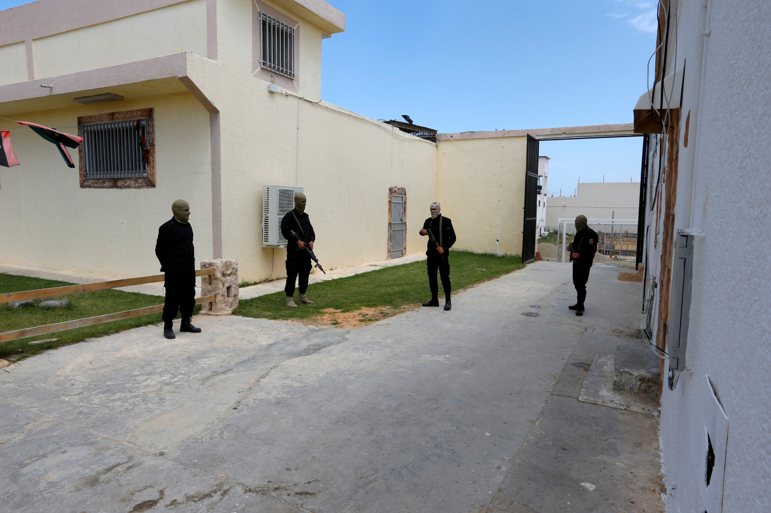 Guards belonging to the Libyan internationally recognized pro-government forces stand in front of a prison, where prisoners from eastern Libyan forces are being held in Ain Zara, south of Tripoli, Libya April 11, 2019. REUTERS/Ismail Zitouny - RC14FB4A3E30