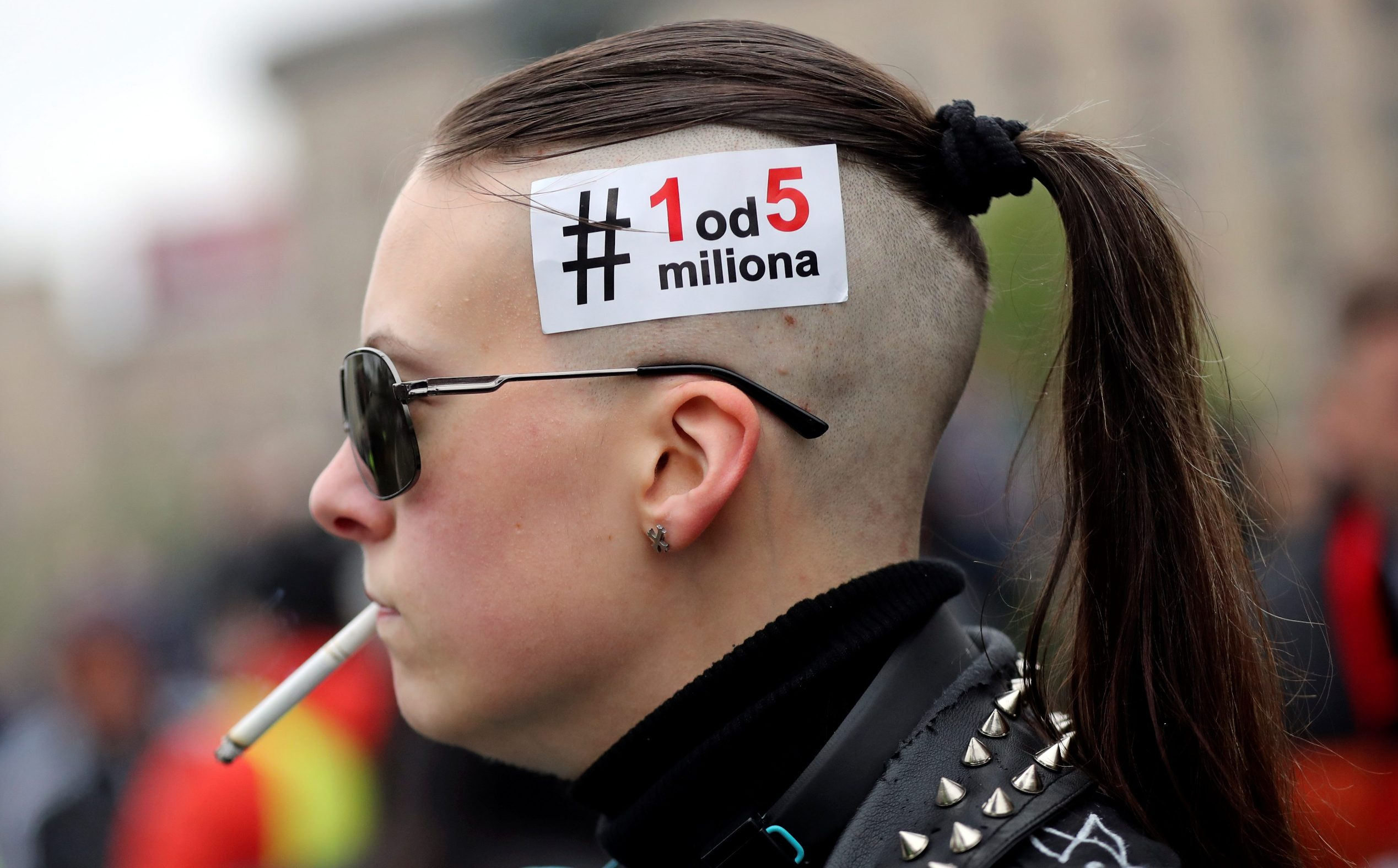 A demonstrator wears a sticker during a protest against Serbia's President Aleksandar Vucic and his government, in front of the Parliament Building in central Belgrade, Serbia, April 13, 2019. The sticker reads