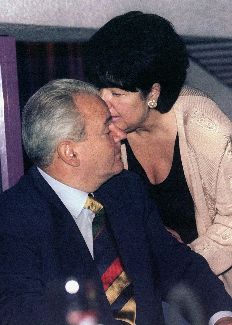 Former Yugoslav President Slobodan Milosevic (L) listens to his wife and coalition partner Mira Markovic (R) during an opening of a nightclub owned by their daughter Marija on this July 22, 1997 file photo, the night before he was sworn in as Yugoslav President. Slobodan Milosevic's 13-year rule left Yugoslavia's dominant republic, Serbia, with an unofficial jobless rate of around 50 percent, inflation running at around 50 percent and an economy which contracted some 30 percent in 1999. More backers of ousted Yugoslav President Slobodan Milosevic were reported on Wednesday to have fled the country or resigned while his parties made a last ditch stand to thwart democratic change.PICTURE TAKEN 22 JULY 1997.  PEK/ - RP2DRHZUOHAB