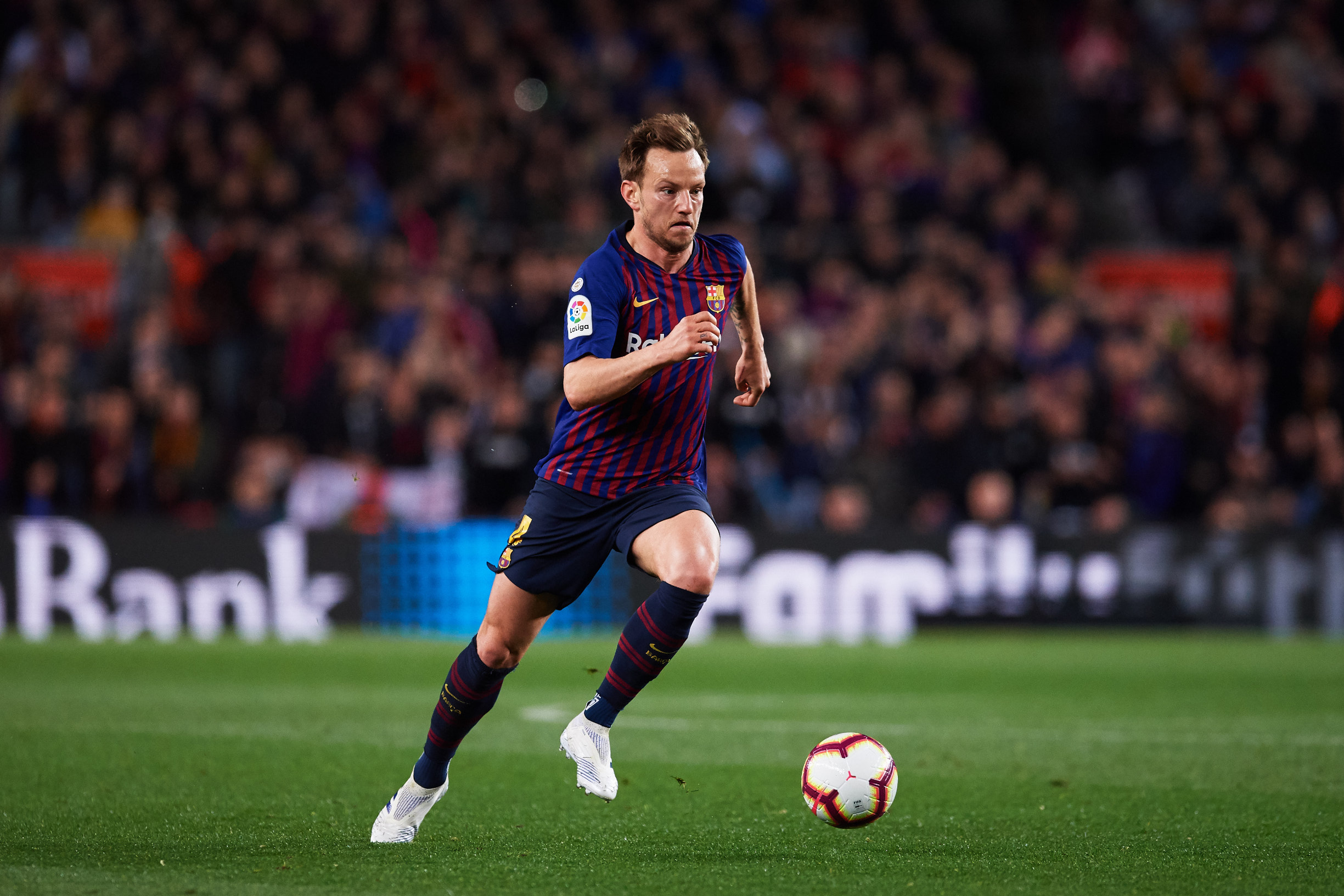 BARCELONA, SPAIN - APRIL 06: Ivan Rakitic of FC Barcelona runs the ball during the La Liga match between FC Barcelona and  Club Atletico de Madrid at Camp Nou on April 06, 2019 in Barcelona, Spain. (Photo by Alex Caparros/Getty Images)