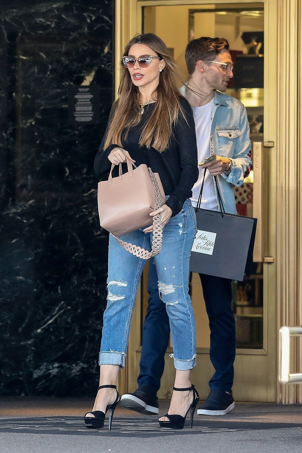 Beverly Hills, CA  - *EXCLUSIVE* - Sofia Vergara is out in Los Angeles getting some hard-earned cash at Sax On Fifth Ave. The wind sweeps the actress' hair as she exits the luxury retailer next to a male companion that carries her shopping bag.  Pictured: Sofia Vergara    *UK Clients - Pictures Containing Children Please Pixelate Face Prior To Publication*, Image: 424111369, License: Rights-managed, Restrictions: , Model Release: no, Credit line: Profimedia, Backgrid USA