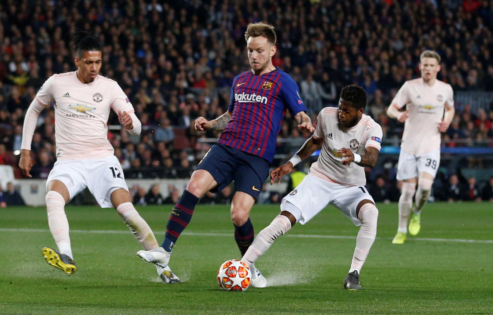Soccer Football - Champions League Quarter Final Second Leg - FC Barcelona v Manchester United - Camp Nou, Barcelona, Spain - April 16, 2019  A penalty is awarded after this challenge from Manchester United's Fred on Barcelona's Ivan Rakitic before the decision is reversed after a VAR review   Action Images via Reuters/Carl Recine