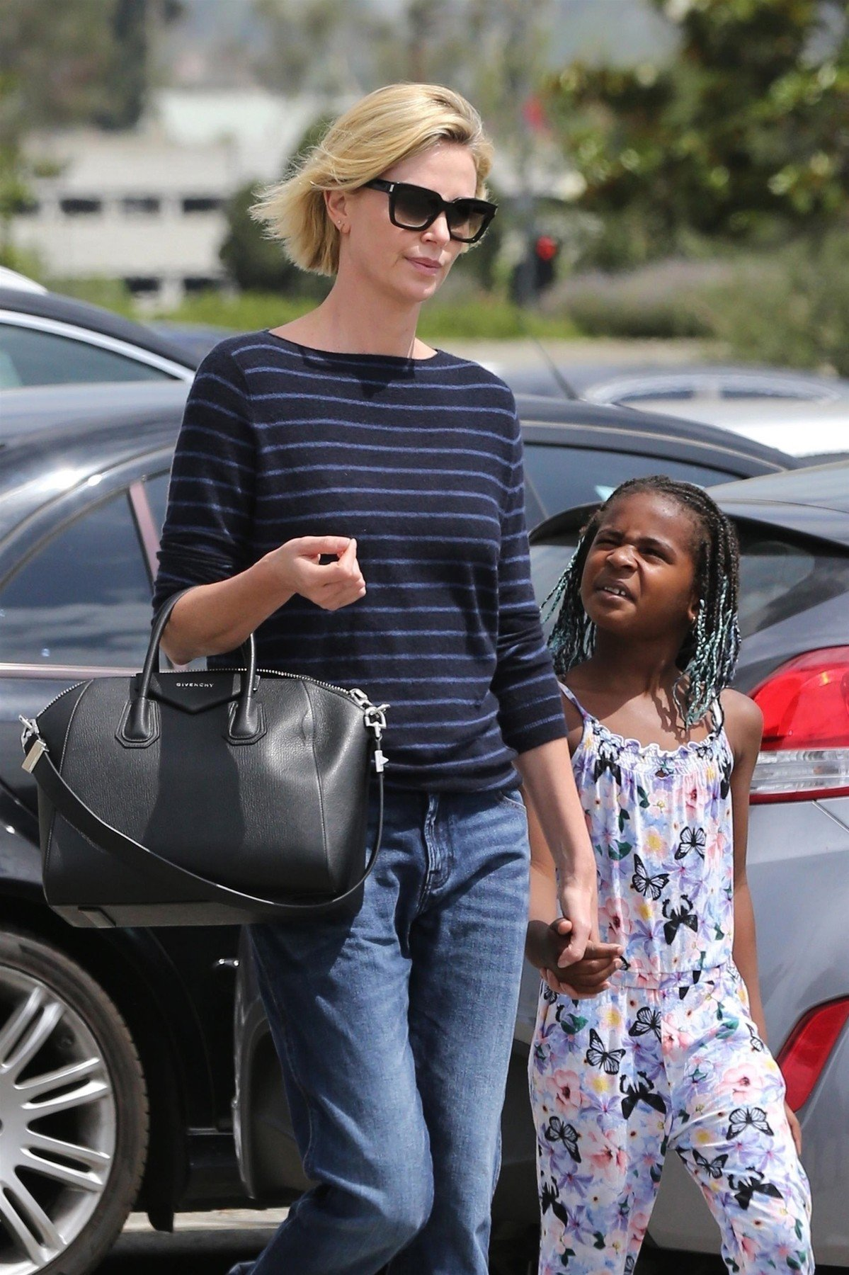 Los Angeles, CA  - *EXCLUSIVE*  - Actress Charlize Theron is seen visiting the Federal Building in Los Angeles with her son Jackson. Charlize was keeping things casual in a blue sweater and blue jeans during the family outing.  Pictured: Charlize Theron, Jackson Theron    *UK Clients - Pictures Containing Children Please Pixelate Face Prior To Publication*, Image: 377456853, License: Rights-managed, Restrictions: , Model Release: no, Credit line: Profimedia, Backgrid USA