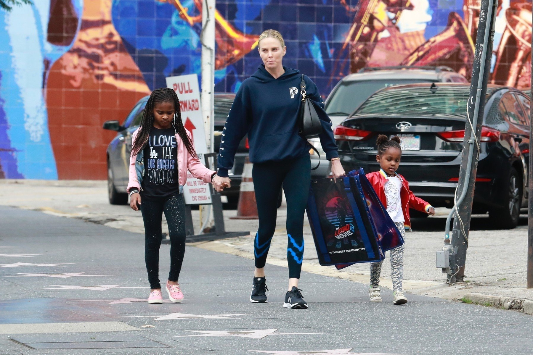 Hollywood, CA  - *EXCLUSIVE*  - Actress, Charlize Theron, is joined by her kids, Jackson and August Theron, for a trip to the premiere of the Lego Movie 2 in Los Angeles. The family step out in casual wear sporting hoodies, bomber jackets, and sneakers.  Pictured: Charlize Theron, August Theron, Jackson Theron     *UK Clients - Pictures Containing Children Please Pixelate Face Prior To Publication*, Image: 411719605, License: Rights-managed, Restrictions: , Model Release: no, Credit line: Profimedia, Backgrid USA