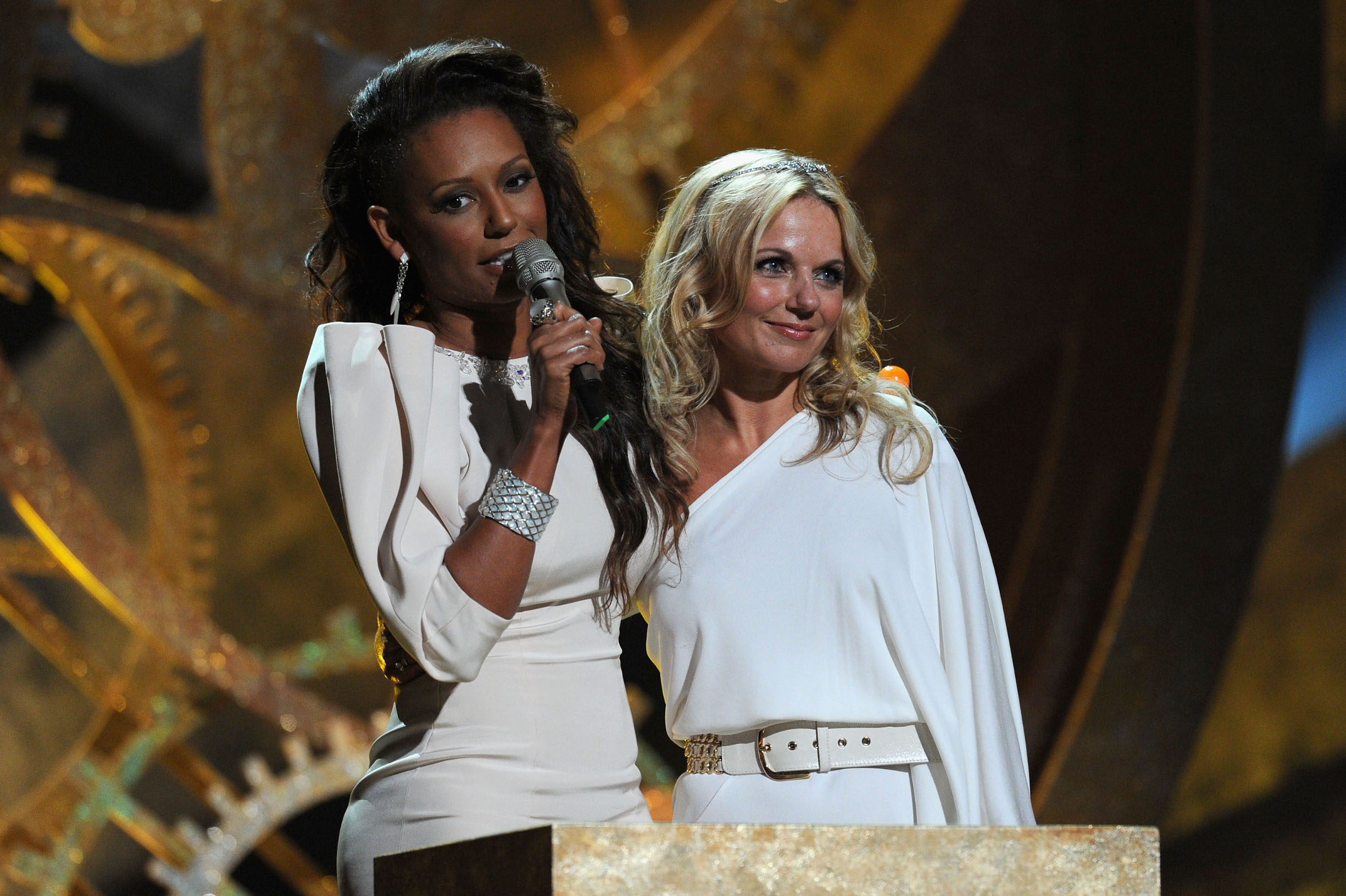 LONDON, ENGLAND - FEBRUARY 16:  Mel B and Geri Halliwell accept the Spice Girls award for 'Brits Performance of 30 Years' on stage at The Brit Awards 2010 at Earls Court on February 16, 2010 in London, England.  (Photo by Gareth Cattermole/Getty Images)