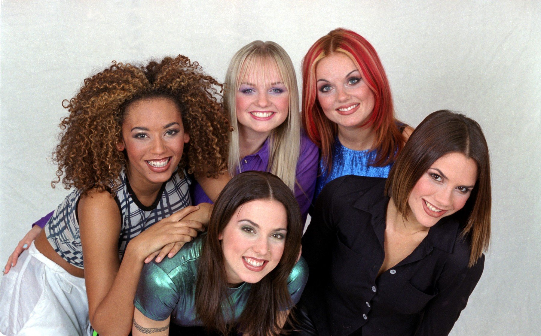 British all girl pop group The Spice Girls pose for a group photograph in the Daily Mirror Studios. They are back ro left to right: Mel B (Scary Spice), Emma Bunton (Baby Spice), Geri Halliwell (Ginger Spice) and  Victoria Adams (Posh Spice). Front is Melanie Chisholm (Sporty Spice). 23rd October 1996., Image: 175232833, License: Rights-managed, Restrictions: , Model Release: no, Credit line: Profimedia, MirrorPix