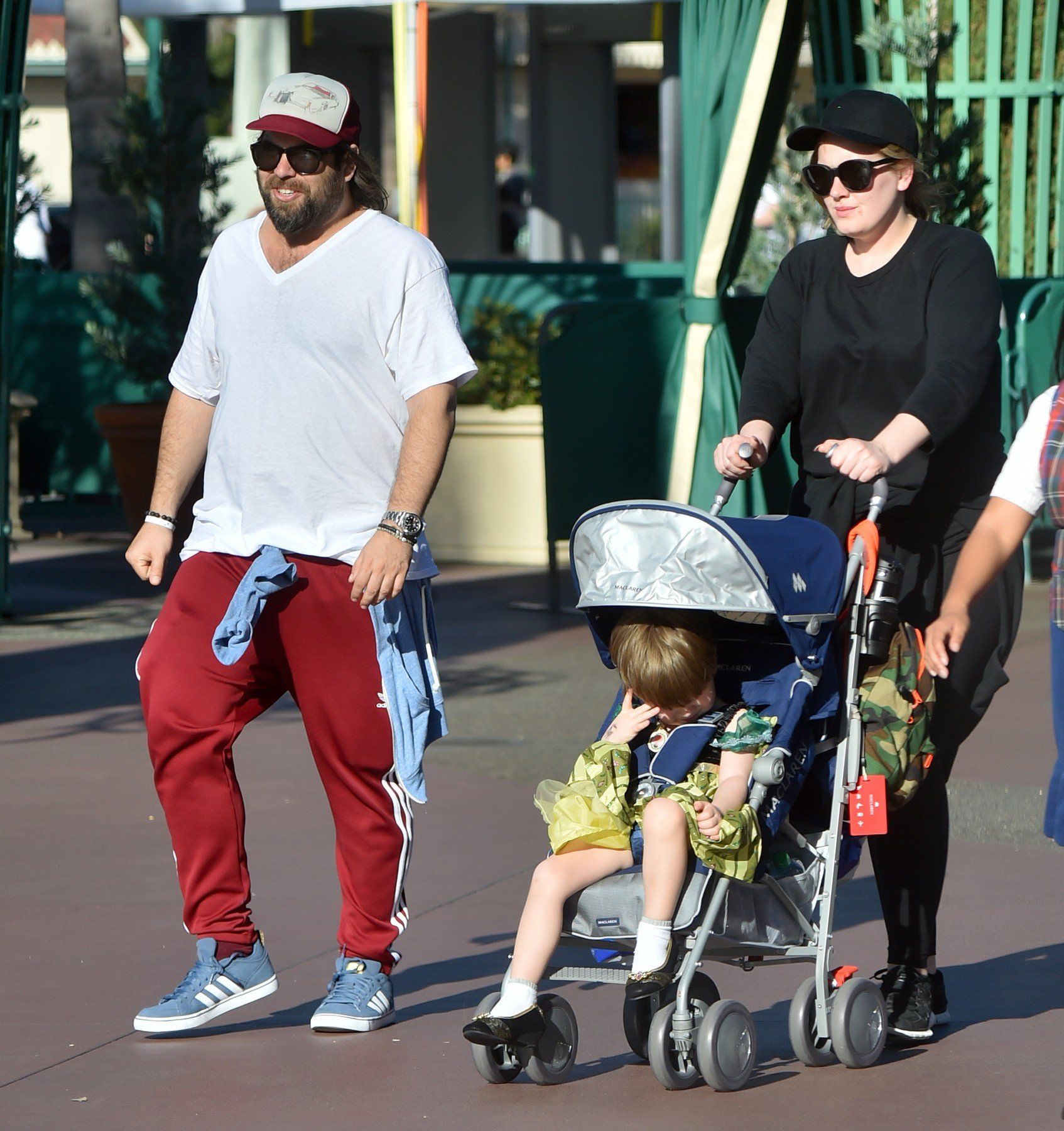 *PREMIUM EXCLUSIVE* **MUST CALL FOR PRICING** Anaheim, CA - Adele and her boyfriend Simon Konecki make it a family day at Disneyland with their son Angelo. The happy family were seen spending an amazing day at Disneyland as they enjoy all the attractions that the park has to offer including rides in Fantasyland and Toontown. Adele keeps a low key presence wearing all black with a cap and shades.  **NO FRANCE, NO GERMANY**         February 14, 2016, Image: 274217032, License: Rights-managed, Restrictions: NO Brazil, NO France, NO Germany, Model Release: no, Credit line: Profimedia, Backgrid USA