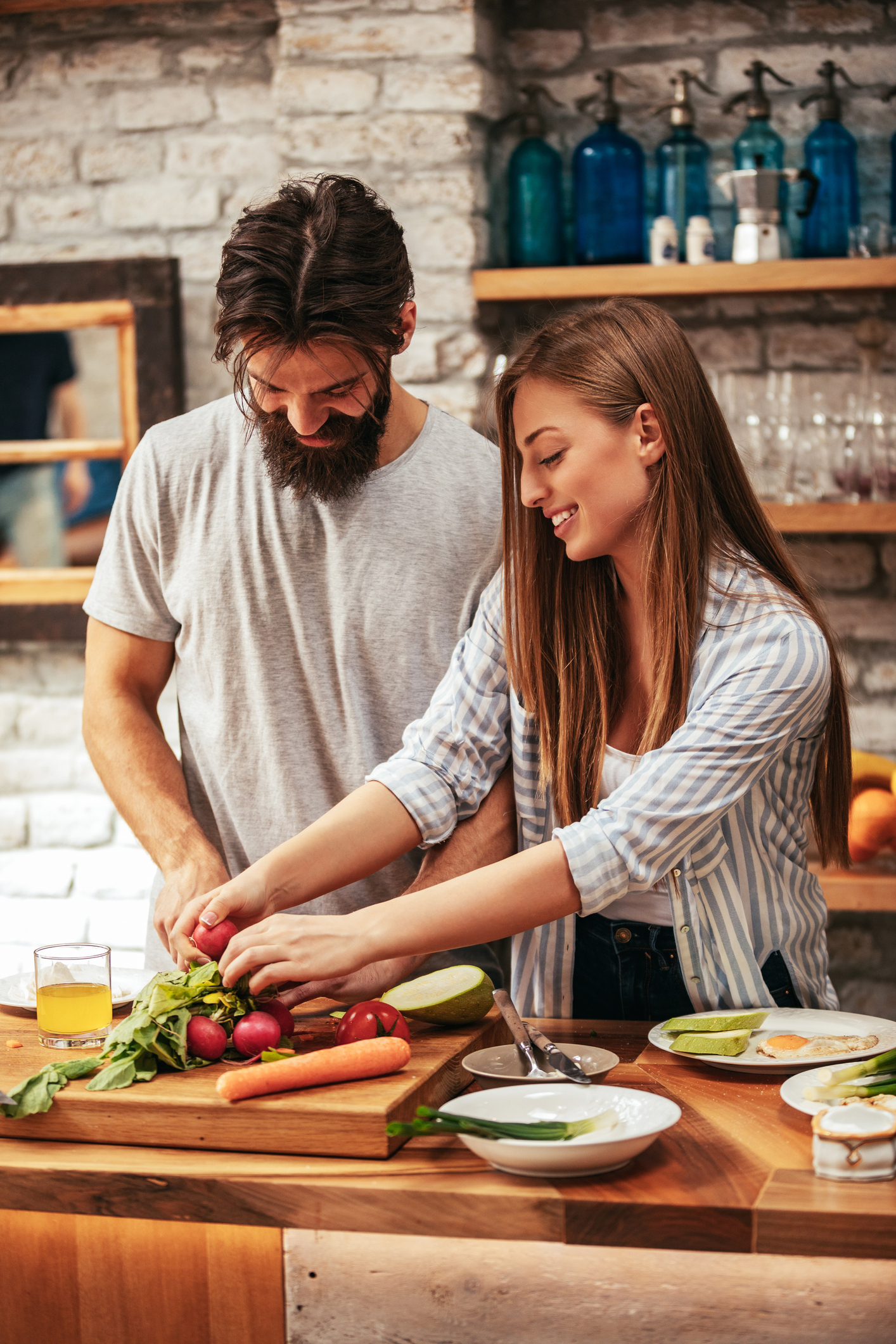 Shot of an attractive young couple cooking in the kitchen