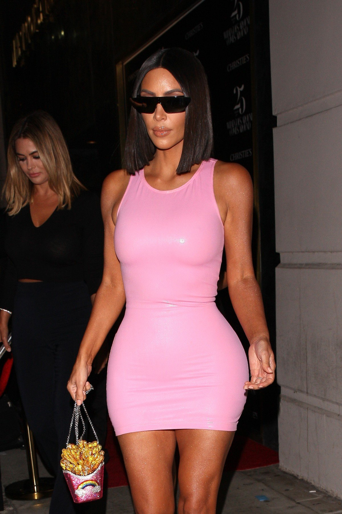 Kim Kardashian shows off her curvy figure in a pink latex dress as she is spotted leaving a event with friends in Beverly Hills. Kim is carrying a french fries inspired purse in hand. 21 Aug 2018, Image: 383549761, License: Rights-managed, Restrictions: World Rights, Model Release: no, Credit line: Profimedia, Mega Agency