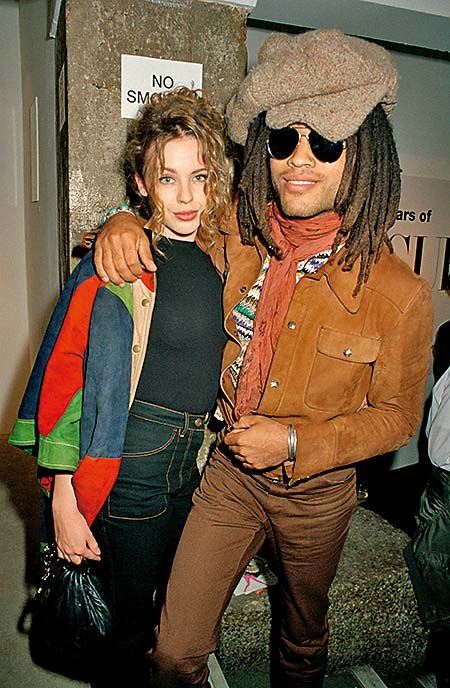 Singers Kylie Minogue and Lenny Kravitz attend a party to celebrate 75 years of Vogue covers, 1991. (Photo by Dave Benett/Getty Images)