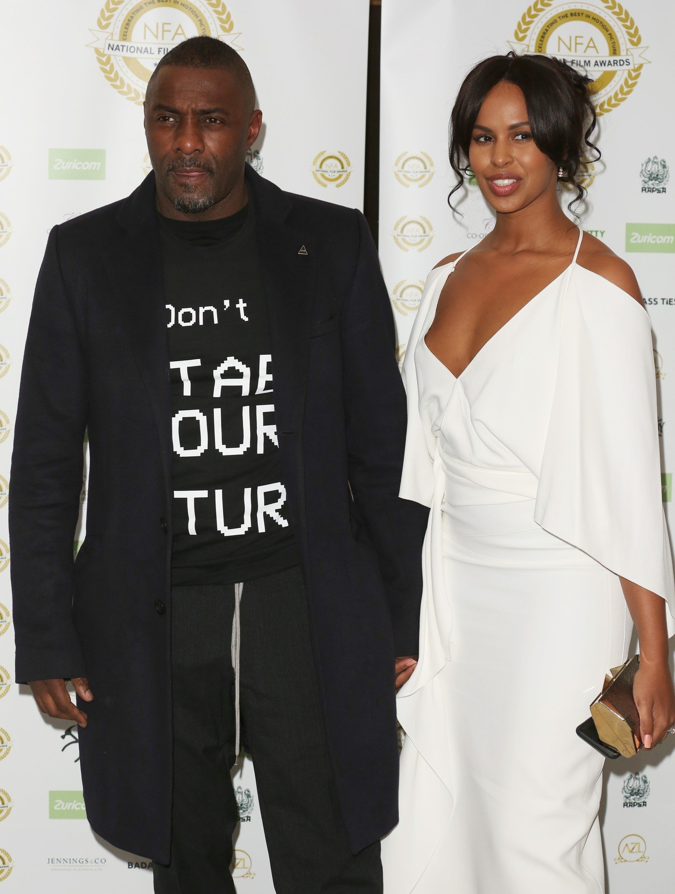 28 March 2019.  Celebrities attend the National Film Awards 2019 at Porchester Hall in London  Pictured: Idris Elba, Sabrina Dhowre, Image: 422757176, License: Rights-managed, Restrictions: , Model Release: no, Credit line: Profimedia, Goff Photos