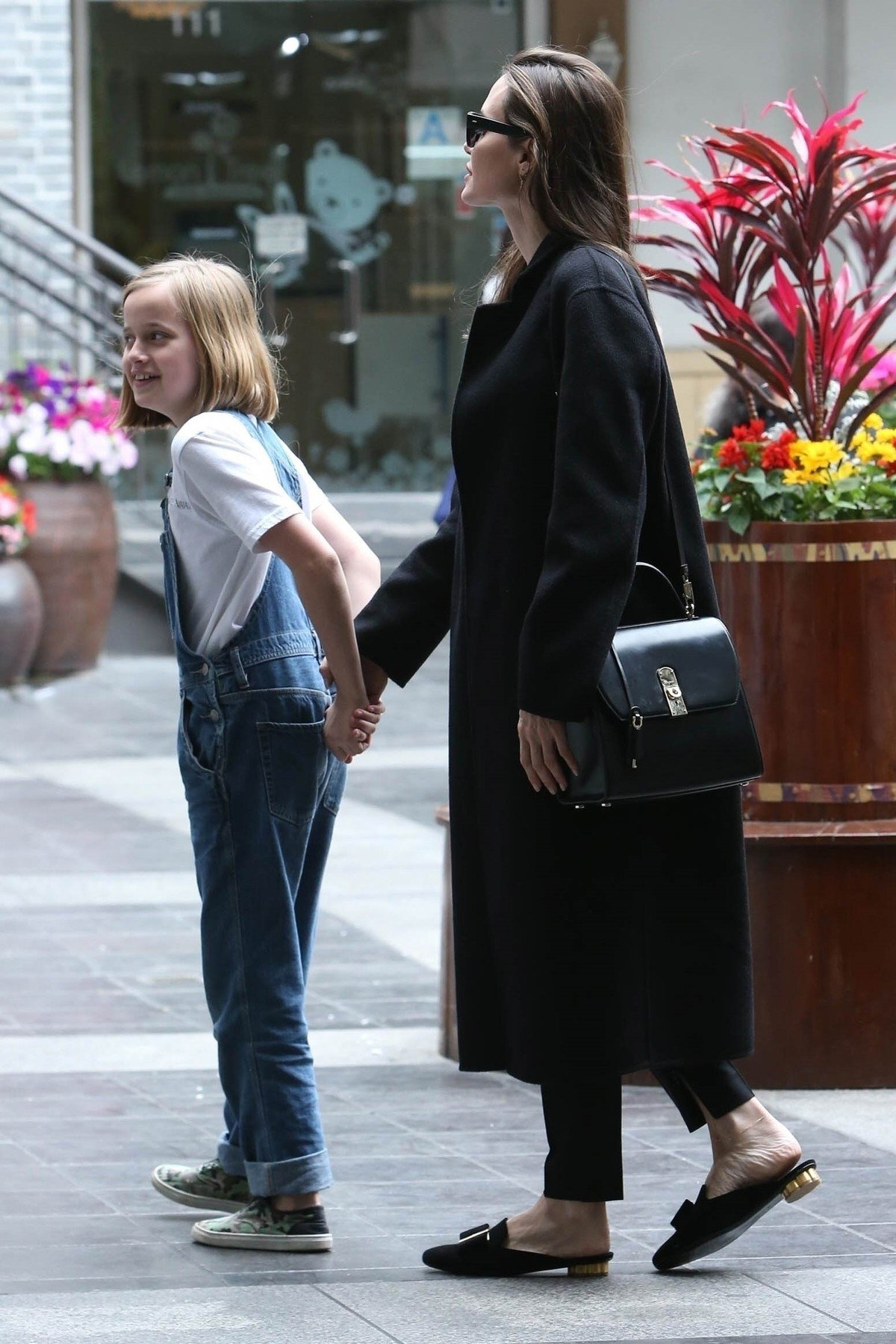 ** RIGHTS: WORLDWIDE EXCEPT IN ITALY ** Los Angeles, CA  - *EXCLUSIVE*  - Actress Angelina Jolie spends the day with daughter Vivienne. Both check out a few stores at a local mall in Los Angeles.  Pictured: Angelina Jolie, Vivienne Jolie-Pitt    *UK Clients - Pictures Containing Children Please Pixelate Face Prior To Publication*, Image: 429548460, License: Rights-managed, Restrictions: , Model Release: no, Credit line: Profimedia, Backgrid USA
