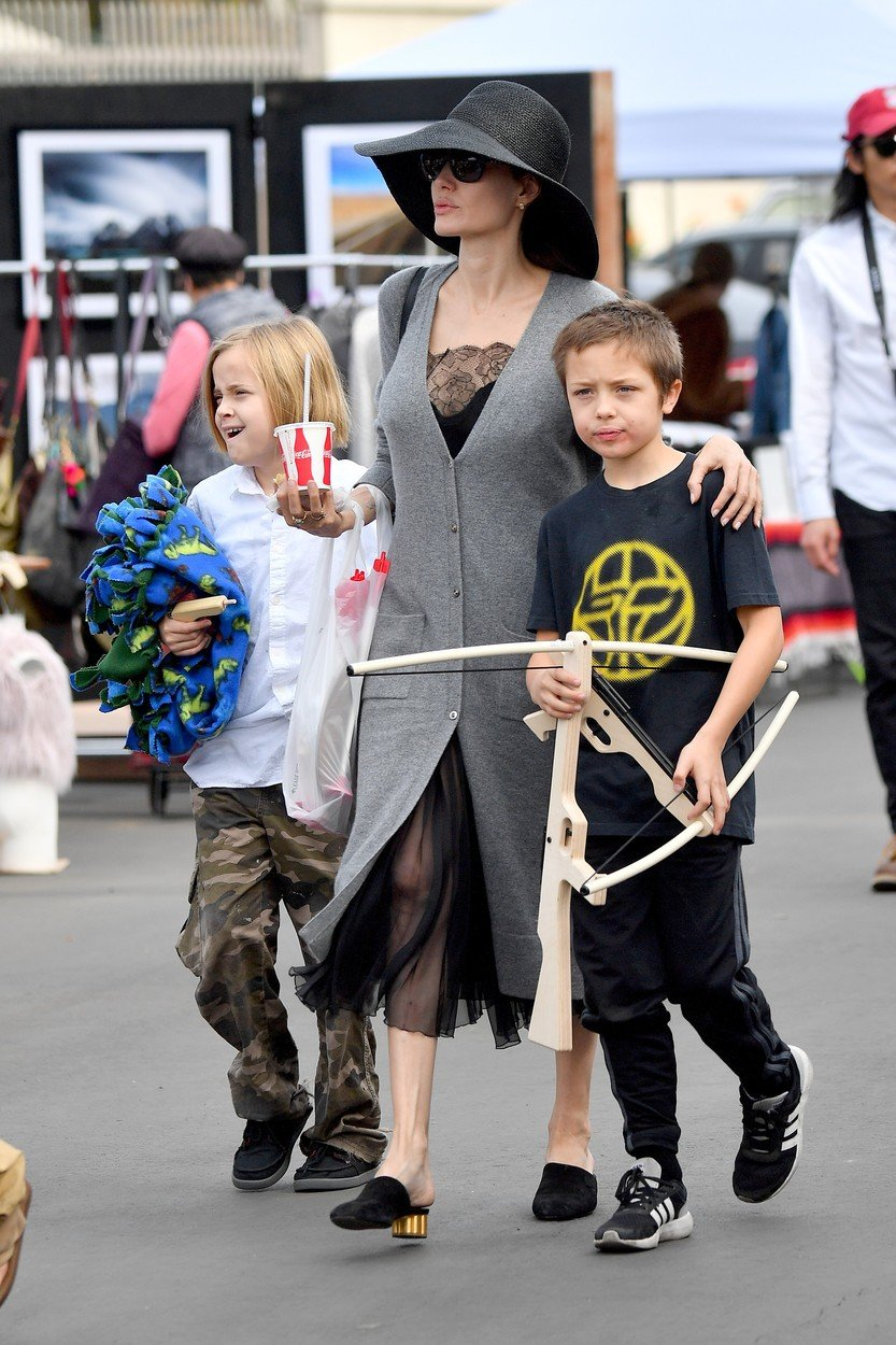 Angelina Jolie takes her kids to the Rosebowl flea market and buys a toy crossbow for them. The group, joined by a single bodygaurd, was seen walking through the Flea market, checking out different stands. she bought some jewelry and a cross bow for the kids. it was a toy, not a real one. they also were sen stopping for snacks including. a pretzel, some coke and chips  ***SPECIAL INSTRUCTIONS*** Please pixelate children's faces before publication.***. 10 Dec 2017, Image: 357456951, License: Rights-managed, Restrictions: World Rights, Model Release: no, Credit line: Profimedia, Mega Agency