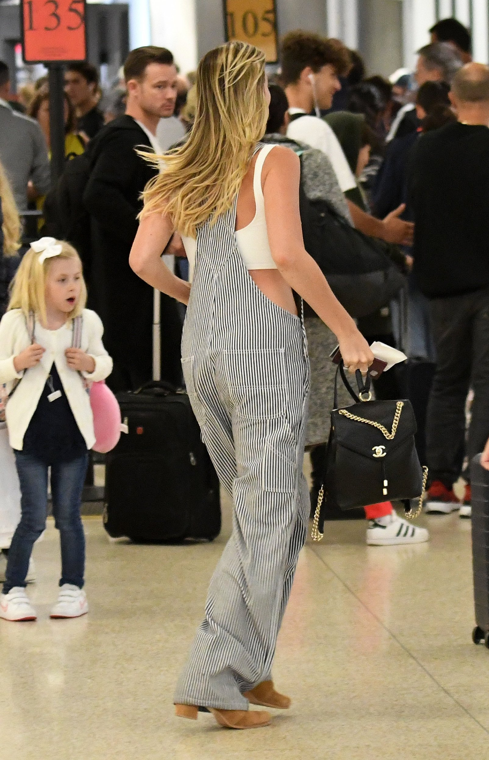 EXCLUSIVE: Actress Margot Robbie and husband Tom Ackerley are seen running through Miami International Airport  to catch a flight in Miami, Florida. The actress looked cute in a crop top under stripped overalls. 27 Apr 2019, Image: 429404246, License: Rights-managed, Restrictions: World Rights, Model Release: no, Credit line: Profimedia, Mega Agency