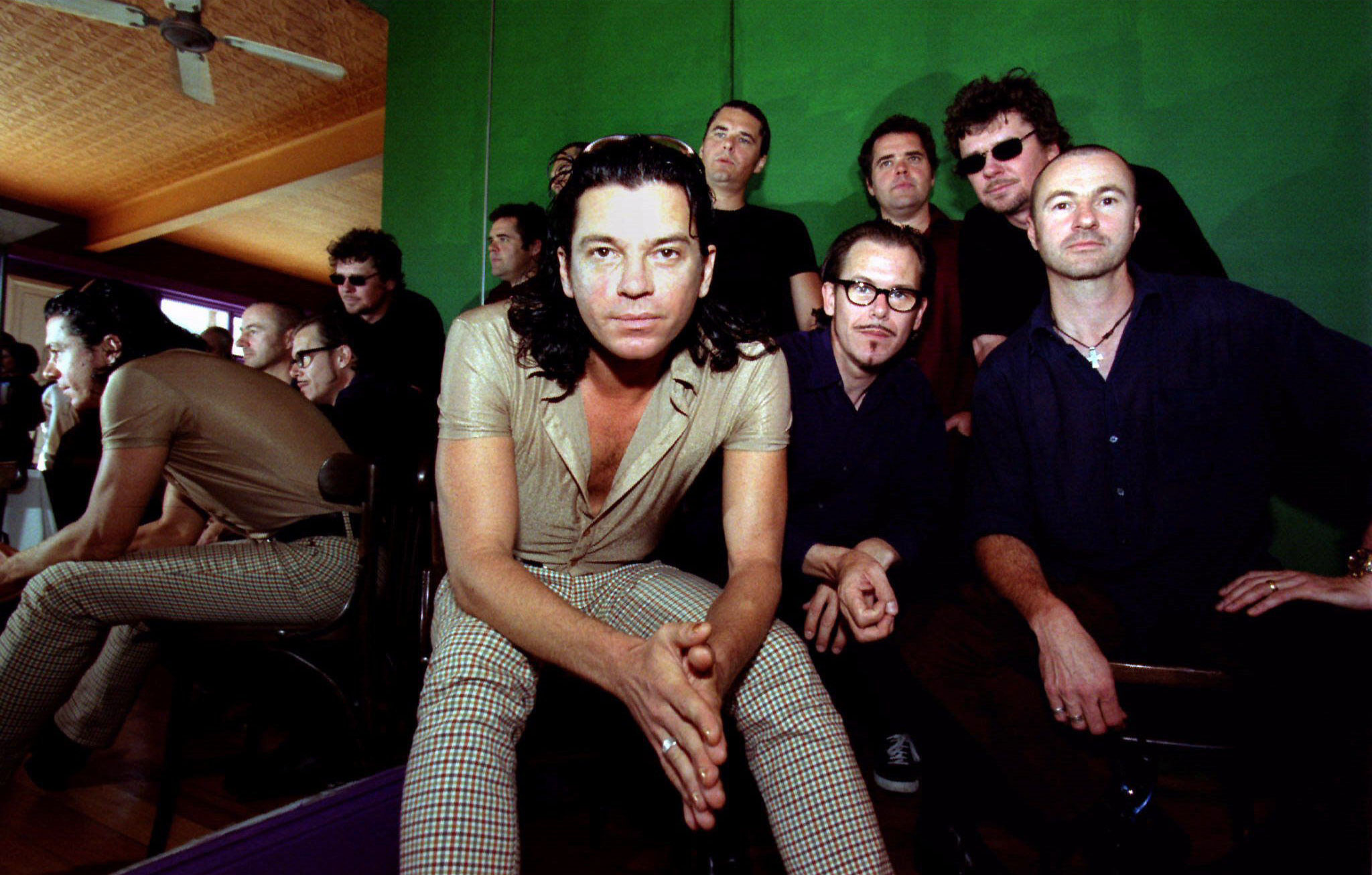 FILE PHOTO 25SEP96 - Australian band INXS, (L to R) lead singer Michael Hutchence, Jon Farriss, Kirk Pengilly, Andrew Farriss, Tim Farriss and Garry Beers pose for photographers in Sydney in this September 25, 1996 file photo. Australian pop star Michael Hutchence has hanged himself in a Sydney hotel, local media reported November 22. Police refused to confirm the reports, carried on a number of radio stations, but said they would hold a news conference today.  AUSTRALIA HUTCHENCE DEATH - RP1DRIDJJKAA