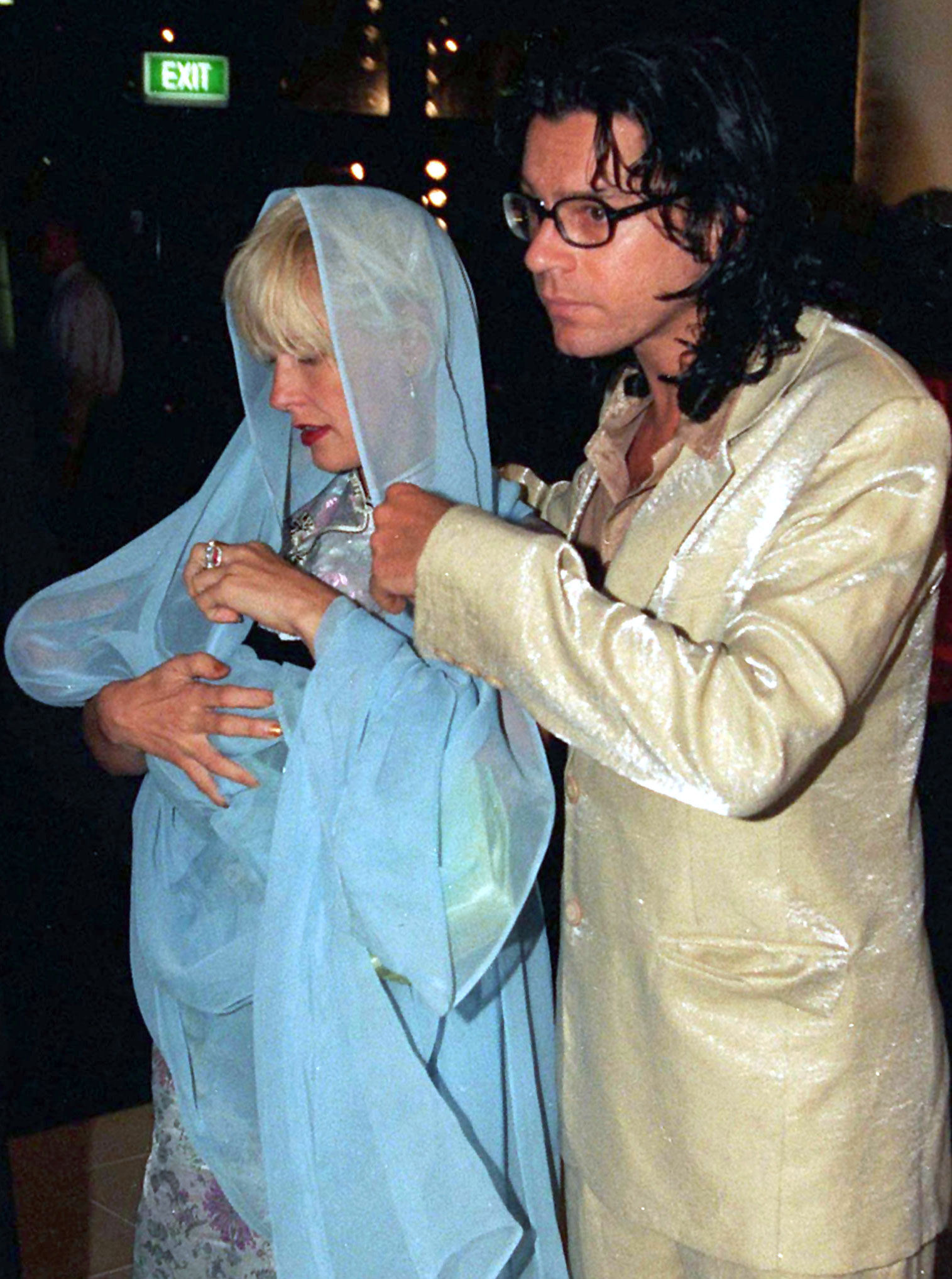 25SEP96 FILE PHOTO - Australian rock star Michael Hutchence (R), pictured with Paula Yates, who craddles their two-month-old baby Heavenly Hiraani in her shawl on the couples arrival at the opening of Sydney's new IMAX theatre . Yates' former husband Bob-Geldof is believed to have obtained a temporary High Court custody order for his three daughters after a substance believed to have been opium was found during a police raid on their London home. **AUSTRALIA OUT** - PBEAHUMXECA