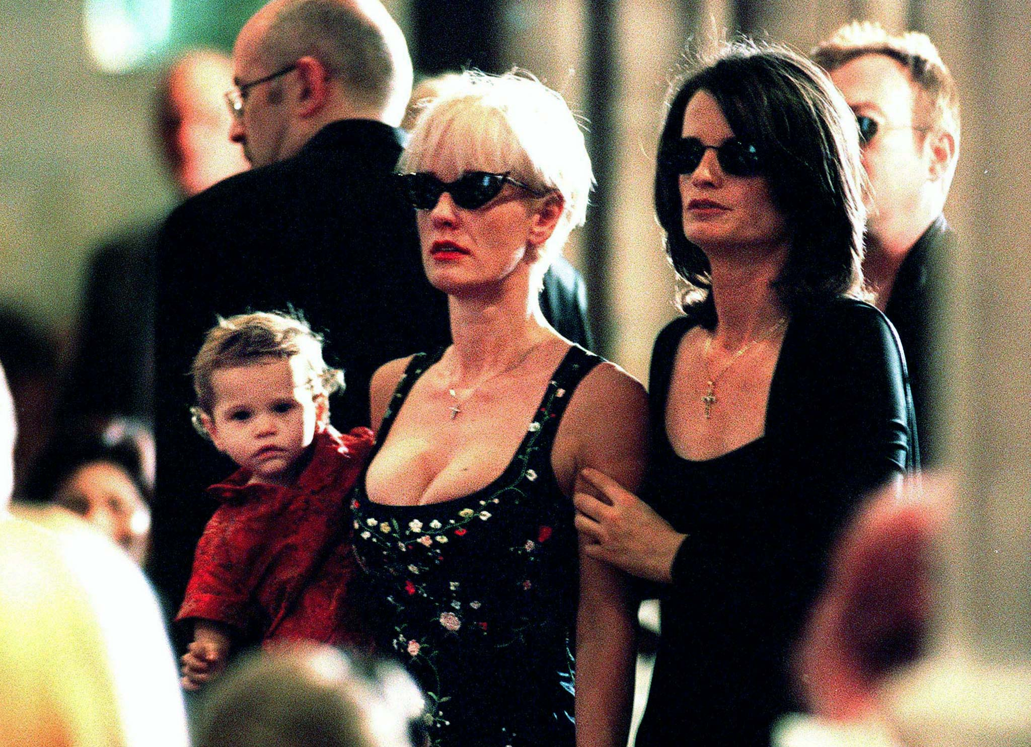 British television personality Paula Yates (C) walks into Sydney's main Anglican cathedral with her daughter Heavenly Hiraani Tiger Lily (L) and a friend during the funeral service for her partner, INXS rock star Michael Hutchence November 27. Thousands of fans watched the emotional service outside on large video screens, whilst relatives, friends and the other band members of INXS crowded inside.    ? QUALITY DOCUMENT - PBEAHUMRBEK