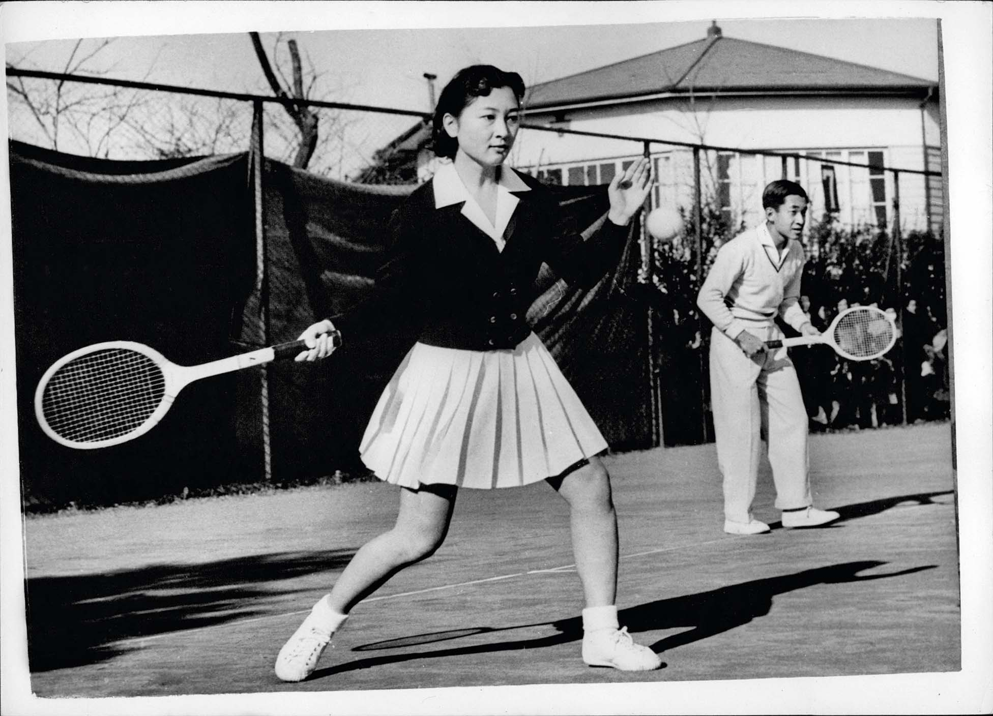 Dec. 12, 1958 - Crown Prince Akihito and Fiancee play Tennis. Crown Prince Akihito of Japan, and his fiancee, Miss Michiko Shoda, partnered each other at tennis over the week-end, at the Tokyo Lawn tennis Club in Azabu, Tokyo. This was the first time they have been photographed together since the announcement of their engagement. Photo shows Crown Prince Akihito and his fiancee, Miss Michiko Shoda, in play when they partnered each other at tennis in Azabu, Tokyo., Image: 210028194, License: Rights-managed, Restrictions: , Model Release: no, Credit line: Profimedia, Zuma Press - Archives