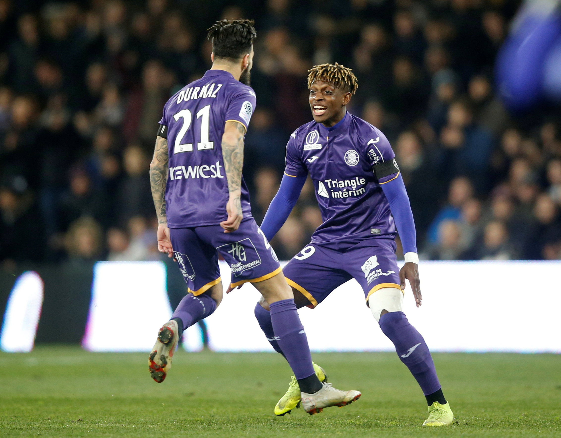 Soccer Football - Ligue 1 - Toulouse v Olympique Lyon - Stadium Municipal de Toulouse, Toulouse, France - January 16, 2019  Toulouse's Jimmy Durmaz celebrates scoring their first goal with Francois Moubandje   REUTERS/Regis Duvignau
