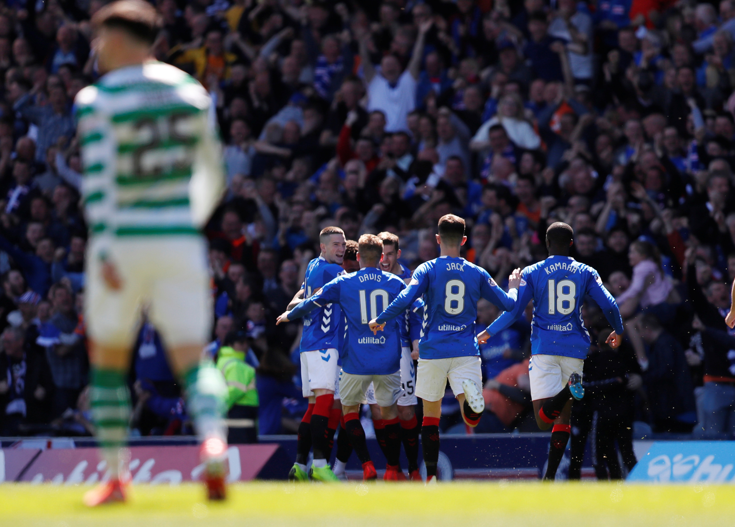 Soccer Football - Premiership - Rangers v Celtic - Ibrox, Glasgow, Britain - May 12, 2019   Rangers' James Tavernier celebrates with team mates after scoring their first goal    REUTERS/Russell Cheyne - RC1228364690