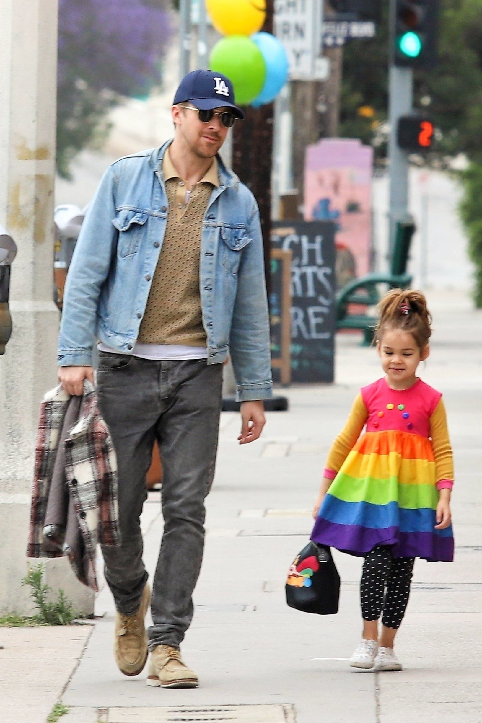 Los Angeles, CA  - *EXCLUSIVE*  - Actor Ryan Gosling takes a stroll with his little one Esmeralda Gosling. The little bundle of sunshine dons a cute rainbow striped dress with polka dotted pants. Ryan keeps things casual in a light blue denim jacket and faded black pants.  Pictured: Ryan Gosling    *UK Clients - Pictures Containing Children Please Pixelate Face Prior To Publication*, Image: 432921251, License: Rights-managed, Restrictions: , Model Release: no, Credit line: Profimedia, Backgrid USA