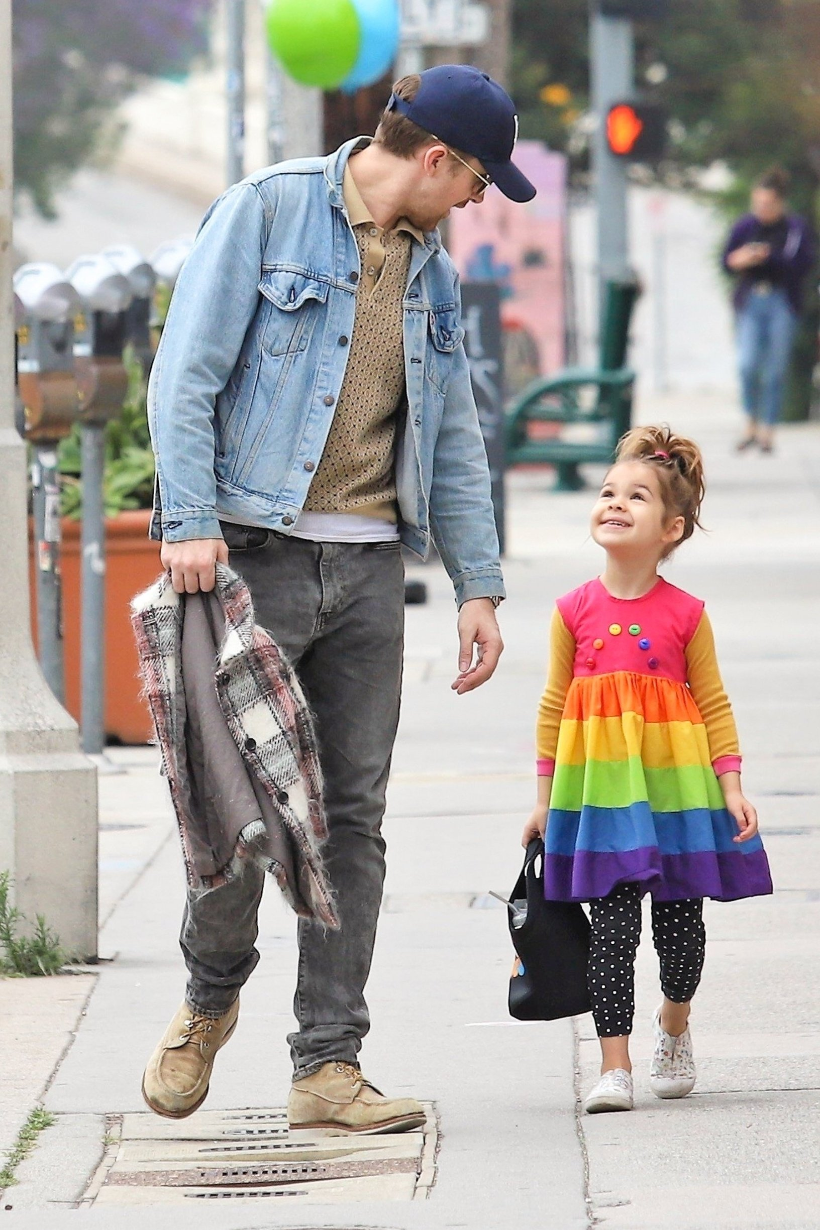 Los Angeles, CA  - *EXCLUSIVE*  - Actor Ryan Gosling takes a stroll with his little one Esmeralda Gosling. The little bundle of sunshine dons a cute rainbow striped dress with polka dotted pants. Ryan keeps things casual in a light blue denim jacket and faded black pants.  Pictured: Ryan Gosling    *UK Clients - Pictures Containing Children Please Pixelate Face Prior To Publication*, Image: 432921268, License: Rights-managed, Restrictions: , Model Release: no, Credit line: Profimedia, Backgrid USA
