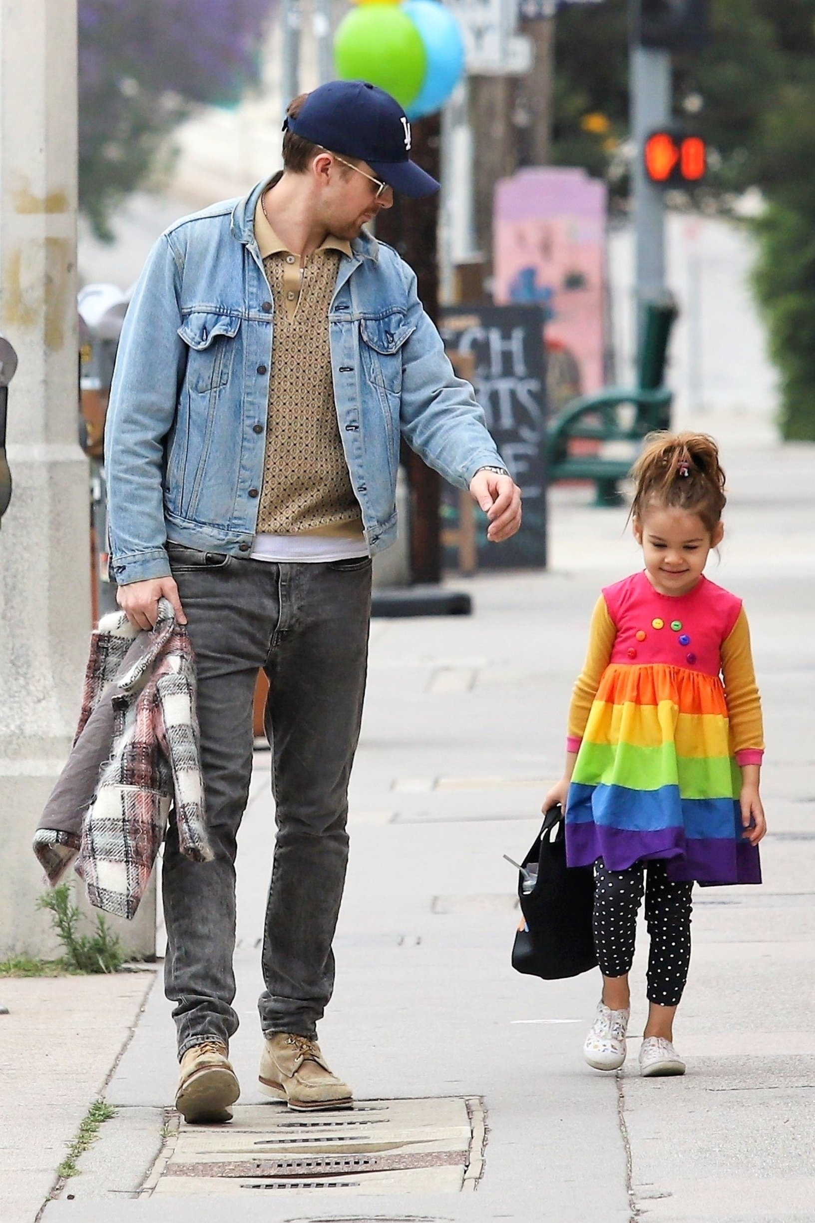 Los Angeles, CA  - *EXCLUSIVE*  - Actor Ryan Gosling takes a stroll with his little one Esmeralda Gosling. The little bundle of sunshine dons a cute rainbow striped dress with polka dotted pants. Ryan keeps things casual in a light blue denim jacket and faded black pants.  Pictured: Ryan Gosling    *UK Clients - Pictures Containing Children Please Pixelate Face Prior To Publication*, Image: 432921288, License: Rights-managed, Restrictions: , Model Release: no, Credit line: Profimedia, Backgrid USA