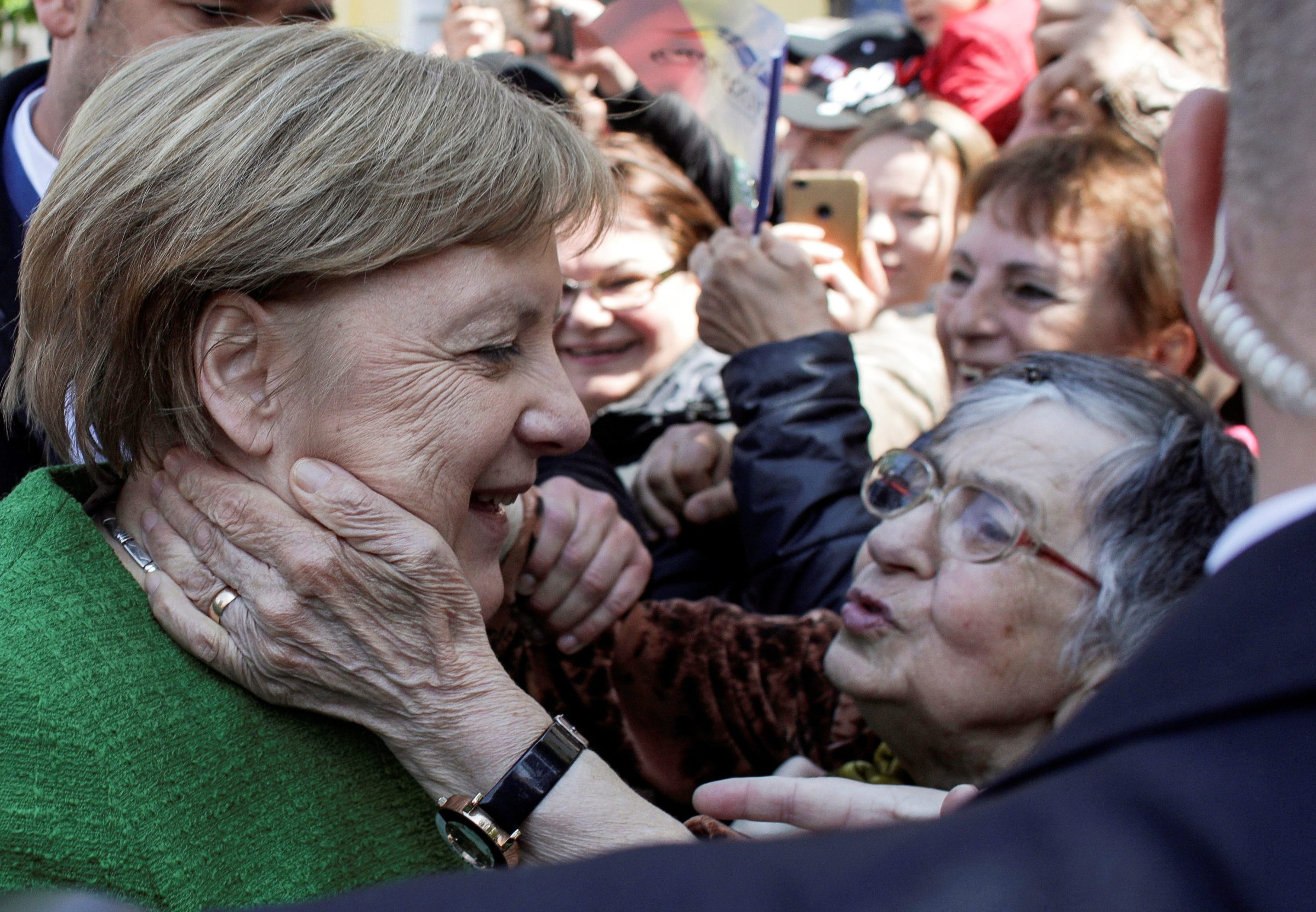 German Chancellor Angela Merkel greets people after posing for a family photo during the informal meeting of European Union leaders in Sibiu, Romania, May 9, 2019. Inquam Photos/Octav Ganea via REUTERS ATTENTION EDITORS - THIS IMAGE WAS PROVIDED BY A THIRD PARTY. ROMANIA OUT. NO COMMERCIAL OR EDITORIAL SALES IN ROMANIA     TPX IMAGES OF THE DAY