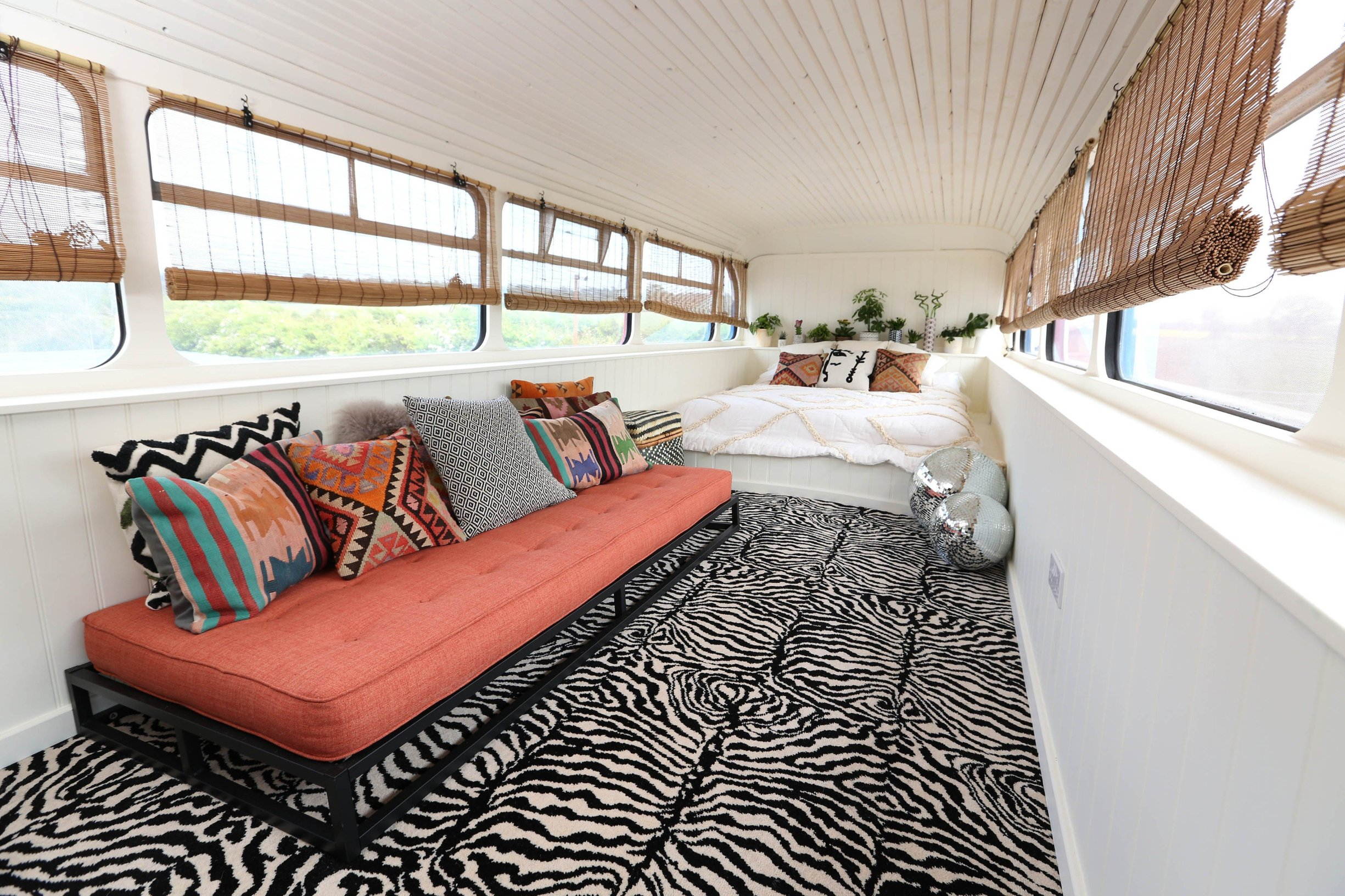 Fancy spicing up your night? Now you can with a stay in the iconic bus from the Spice Girls movie. Host Suzanne Godley teamed up with Airbnb to create this unique and nostalgic stay in time for the Spice Girls reunion tour. The accommodation is made from the original Union Jack bus from the Spice Girls' 1997 movie Spice World, which was then converted into a luxury apartment. The Spice Bus will be situated in the heart of Wembley Park, London, where guests will be able to stay overnight from June 14. The recently renovated living area features pink Union Jack cinema chairs below a Girl Power neon light installation and is fully stocked with vintage 90s magazines and CDs to help recreate the 90s era. With bold interiors, potted plants create a fresh homely feel downstairs while bright colourful scatter cushions surround the central seating area, providing a comfy place for guests to relax and spend time with each other. Upstairs theres a dressing and the adjoining bedroom, which is fitted with a striking animal-print carpet, provides comfy bedding for three guests who get to call the Spice Bus home for the night. Suzanne, who is a Spice Girls superfan, said: When my boss mentioned that he was considering buying the Spice Bus I was desperate to be a part of its renovation. Weve worked hard over the past few months to turn the bus into a home, in keeping with its legacy, and Im so excited to open it up to the public with the support of Airbnb. Being part of this project has been like a dream come true and I cant wait to meet other Spice Girls fans through this experience.. 15 May 2019, Image: 433505137, License: Rights-managed, Restrictions: World Rights, Model Release: no, Credit line: Profimedia, Mega Agency