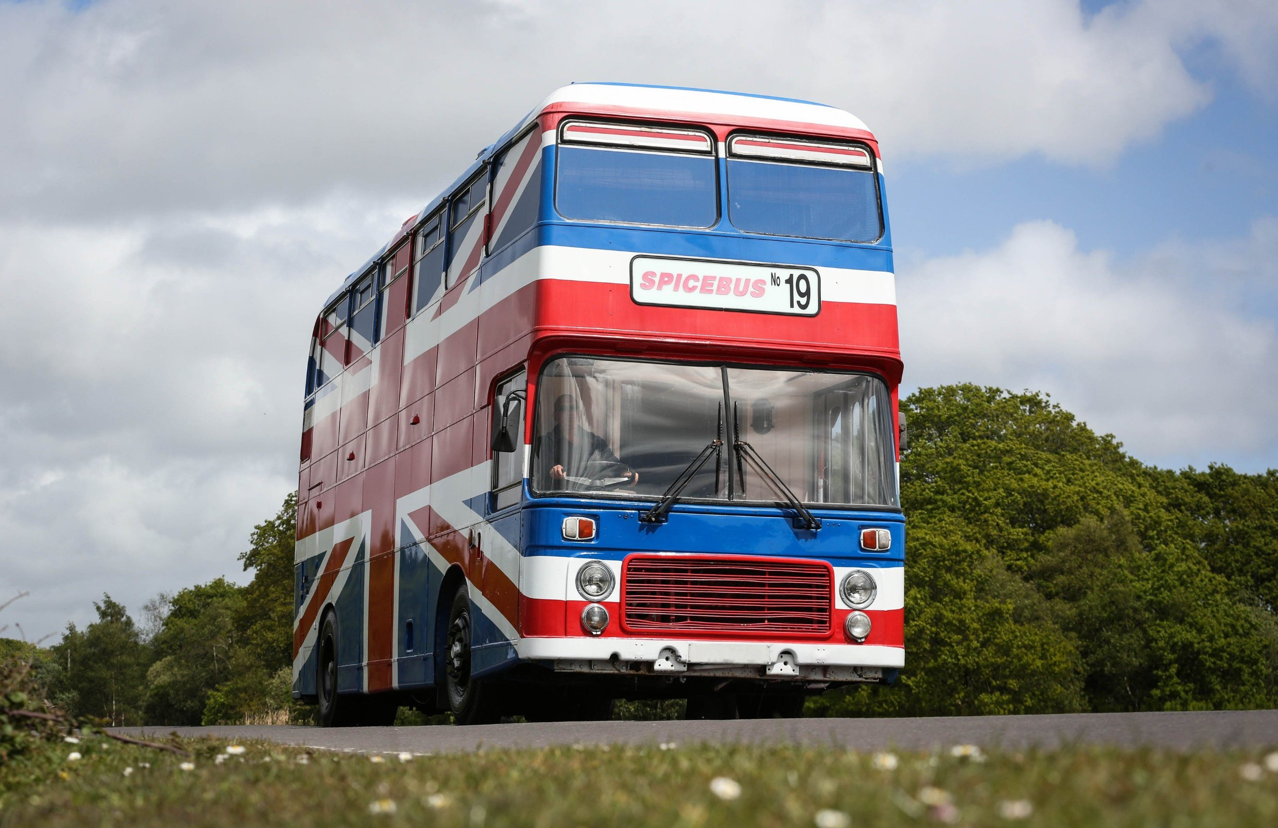 Fancy spicing up your night? Now you can with a stay in the iconic bus from the Spice Girls movie. Host Suzanne Godley teamed up with Airbnb to create this unique and nostalgic stay in time for the Spice Girls reunion tour. The accommodation is made from the original Union Jack bus from the Spice Girls' 1997 movie Spice World, which was then converted into a luxury apartment. The Spice Bus will be situated in the heart of Wembley Park, London, where guests will be able to stay overnight from June 14. The recently renovated living area features pink Union Jack cinema chairs below a Girl Power neon light installation and is fully stocked with vintage 90s magazines and CDs to help recreate the 90s era. With bold interiors, potted plants create a fresh homely feel downstairs while bright colourful scatter cushions surround the central seating area, providing a comfy place for guests to relax and spend time with each other. Upstairs theres a dressing and the adjoining bedroom, which is fitted with a striking animal-print carpet, provides comfy bedding for three guests who get to call the Spice Bus home for the night. Suzanne, who is a Spice Girls superfan, said: When my boss mentioned that he was considering buying the Spice Bus I was desperate to be a part of its renovation. Weve worked hard over the past few months to turn the bus into a home, in keeping with its legacy, and Im so excited to open it up to the public with the support of Airbnb. Being part of this project has been like a dream come true and I cant wait to meet other Spice Girls fans through this experience.. 15 May 2019, Image: 433505192, License: Rights-managed, Restrictions: World Rights, Model Release: no, Credit line: Profimedia, Mega Agency