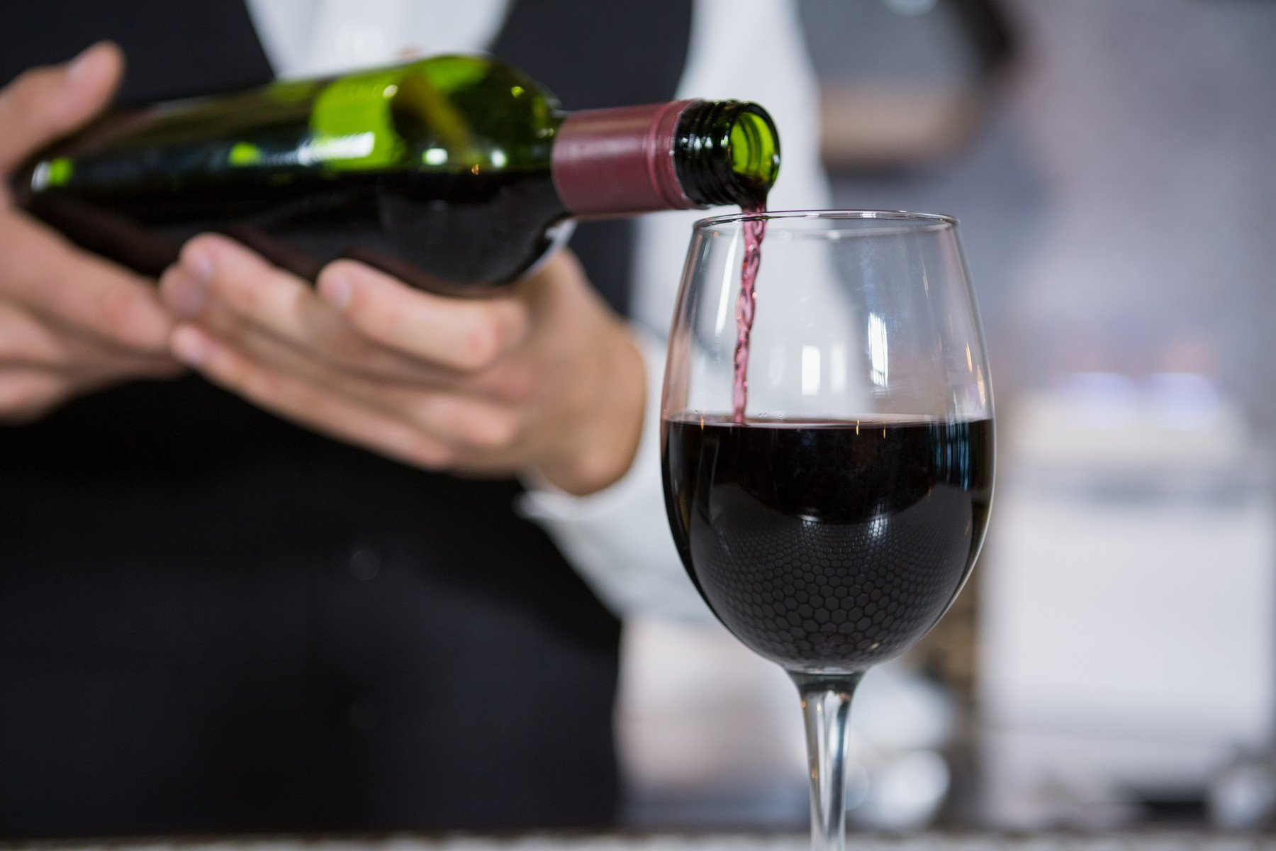 Mid section of bartender pouring red wine on glass in bar counter, Image: 309219027, License: Rights-managed, Restrictions: , Model Release: yes, Credit line: Profimedia, Wavebreak