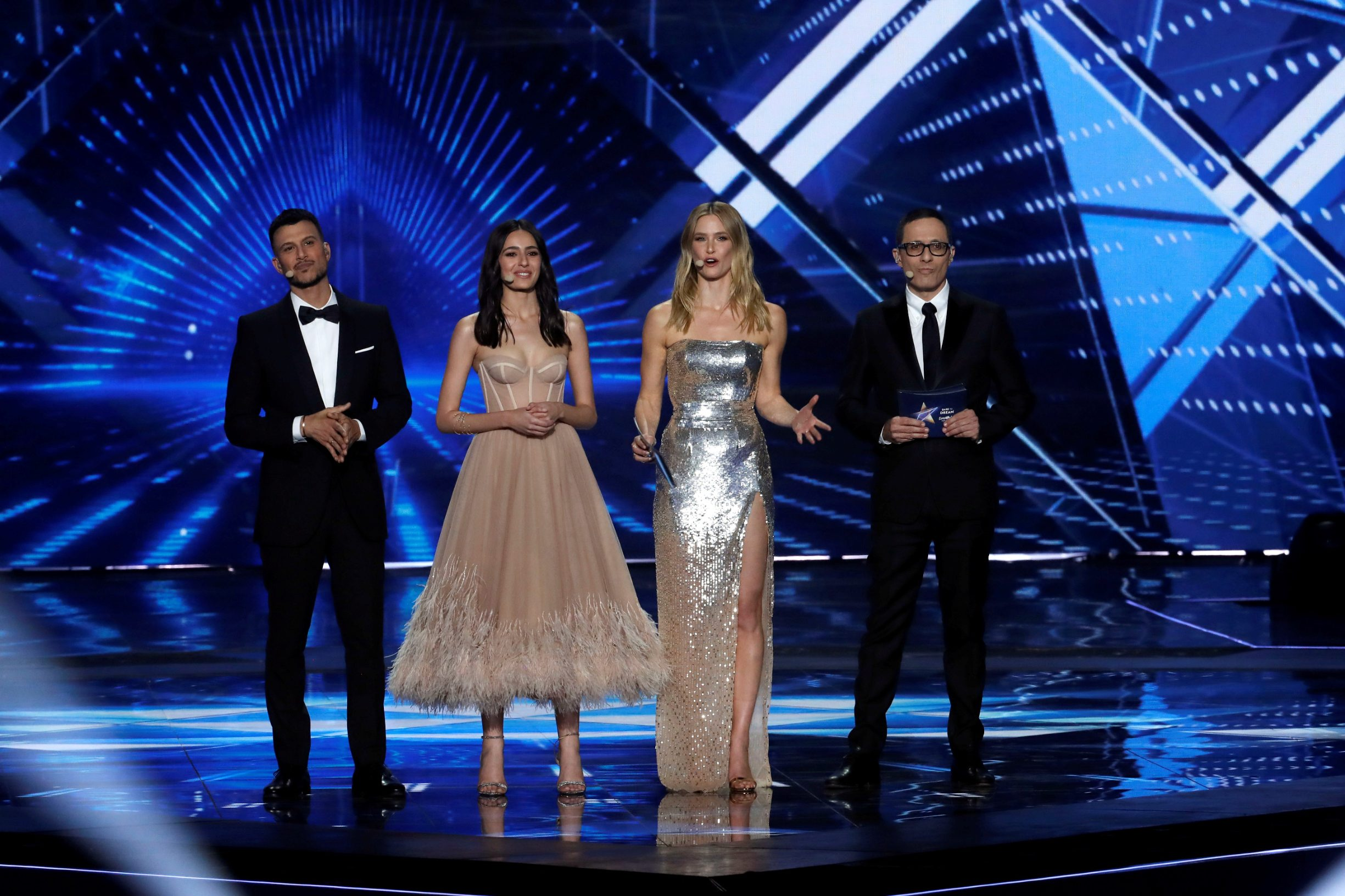 Hosts of the 2019 Eurovision Song Contest, Bar Refaeli, Erez Tal, Assi Azar and Lucy Ayoub stand on stage during the Grand Final of the contest in Tel Aviv, Israel May 18, 2019. REUTERS/Ronen Zvulun