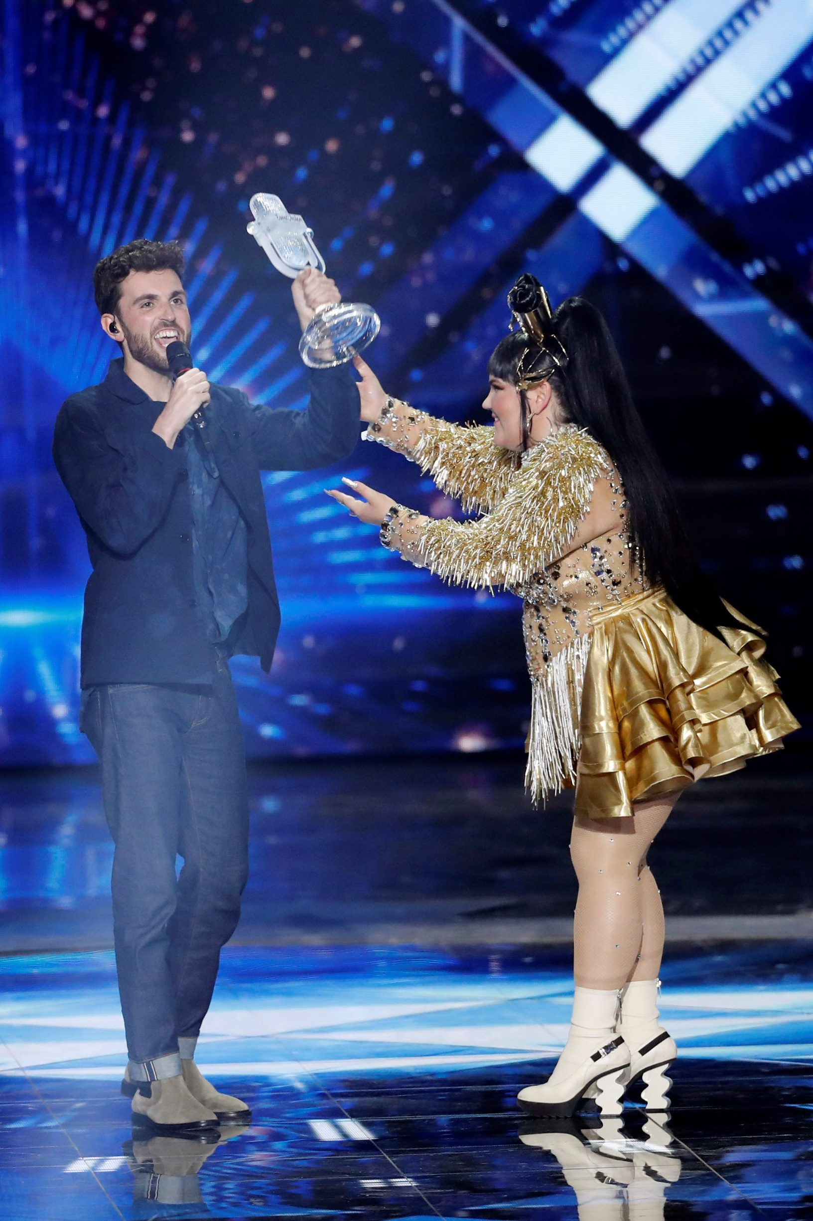 Israel's Netta Barzilai, winner of last year's Eurovision Song Contest, hands the trophy to Duncan Laurence of the Netherlands, the winner of the 2019 Eurovision Song Contest in Tel Aviv, Israel May 19, 2019. REUTERS/Ronen Zvulun