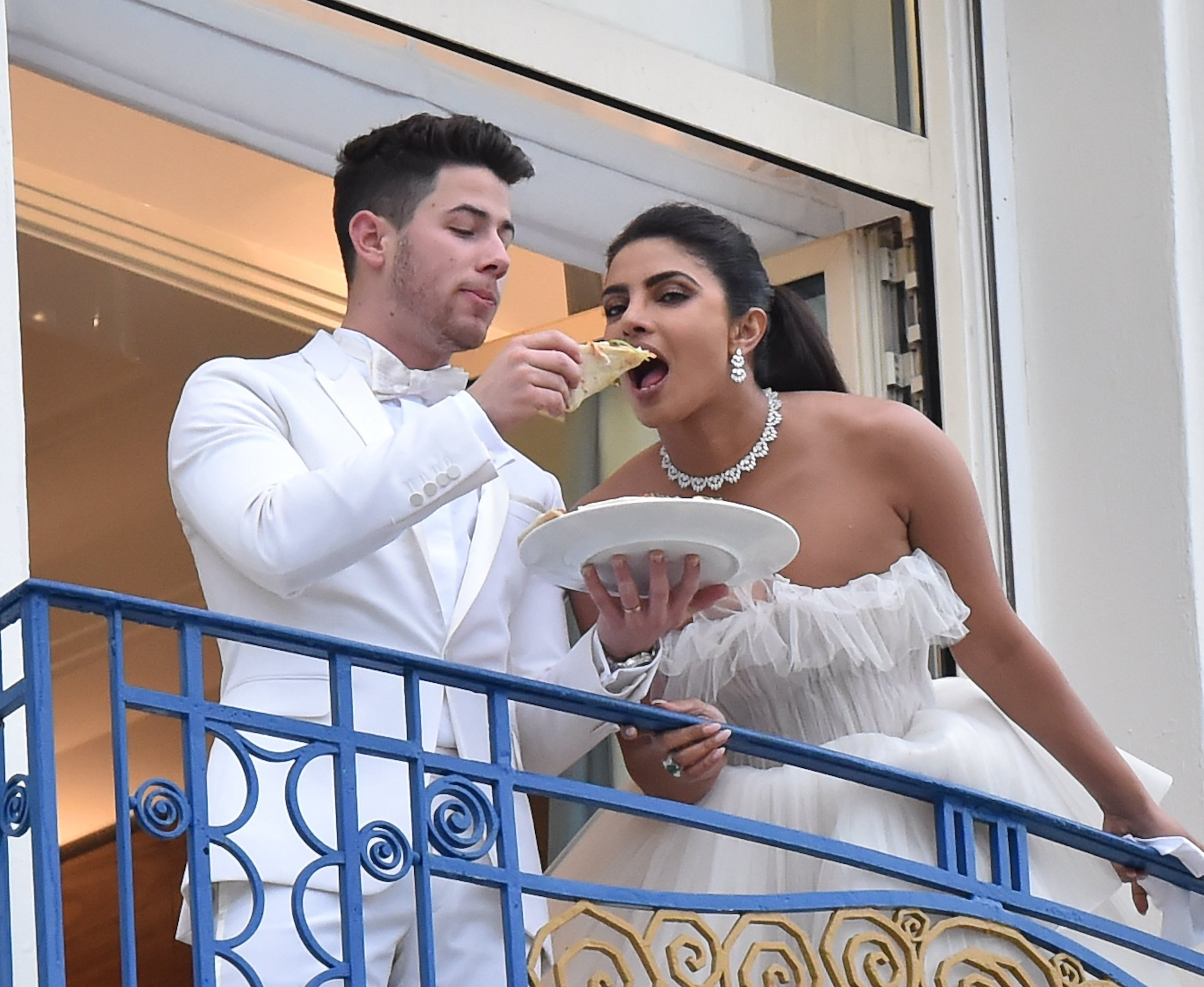Nick Jonas & Priyanka Chopra are seen at the Martinez hotel in their suite feeding Pizza to each other straight after walking the red carpet in Cannes. 18 May 2019, Image: 434518164, License: Rights-managed, Restrictions: World Rights, Model Release: no, Credit line: Profimedia, Mega Agency
