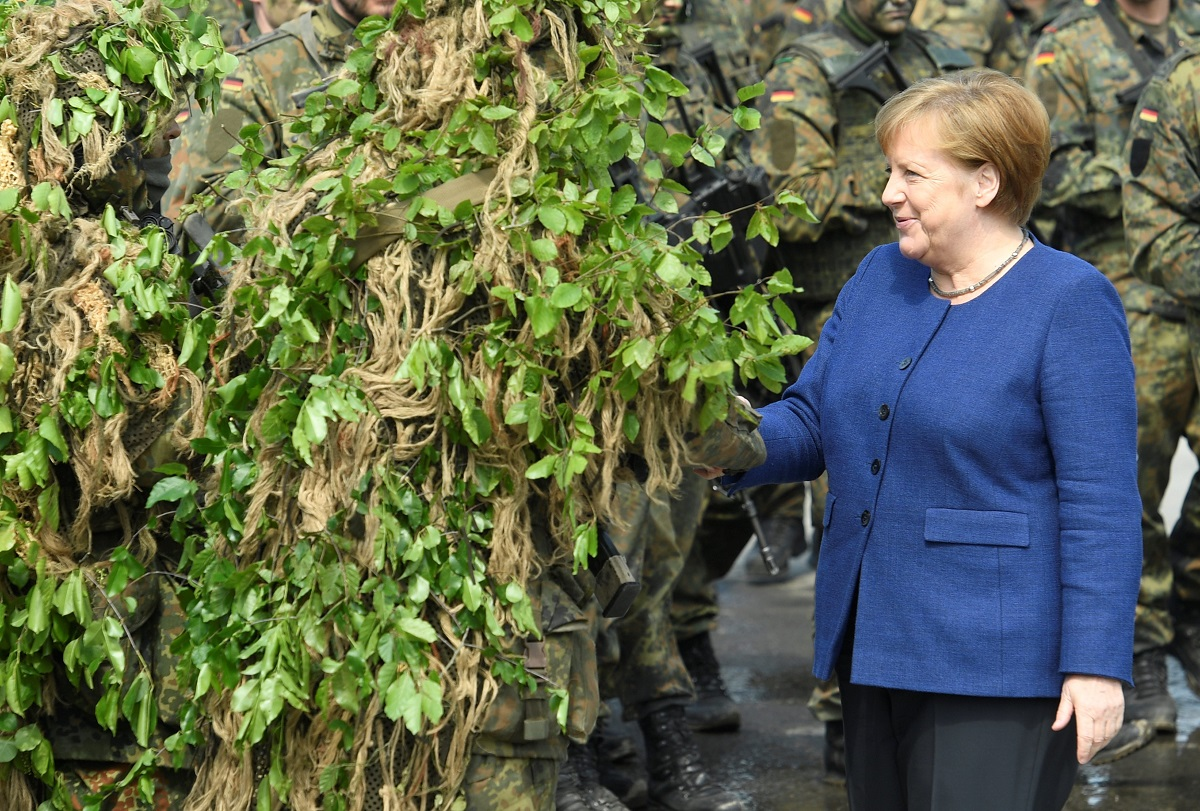 German Chancellor Angela Merkel talks to soldiers during her visit to NATO's new spearhead force