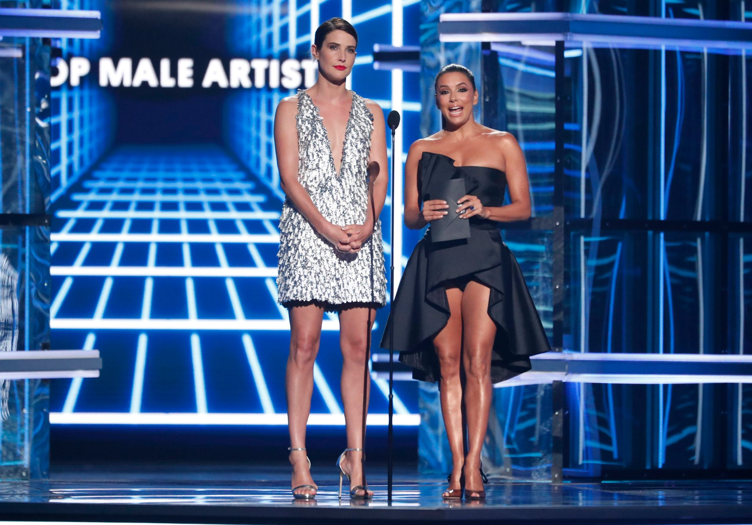 2019 Billboard Music Awards- Show - Las Vegas, Nevada, U.S., May 1, 2019 - Presenters for the Billboard Awards Top Male Artist, Cobie Smulders and Eva Longoria, speak on stage. REUTERS/Mario Anzuoni