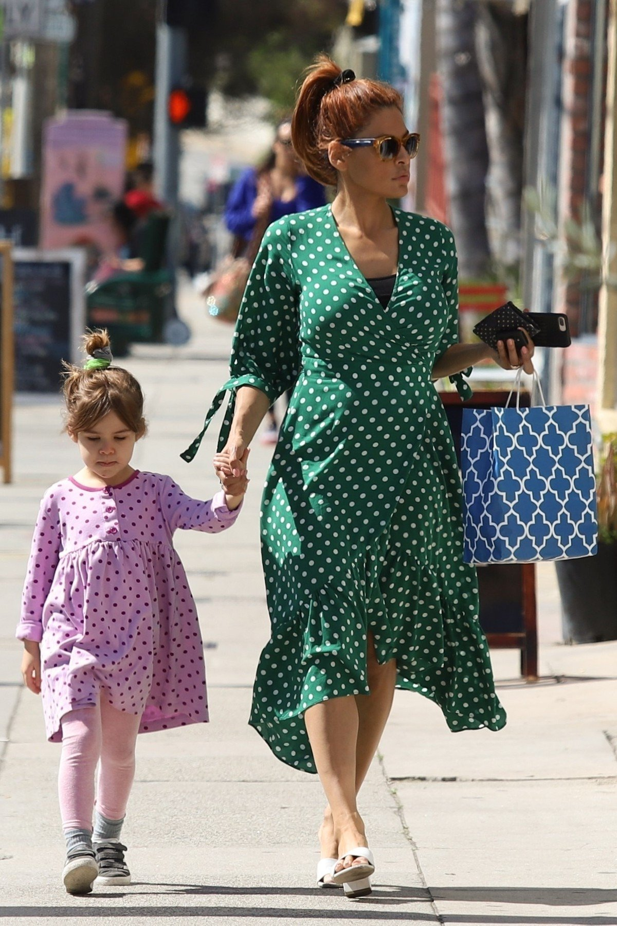 Hollywood, CA  - *EXCLUSIVE*  - Actress Eva Mendes takes her eldest daughter Esmeralda Gosling out to a birthday party in Hollywood. The duo step out to the party wearing polka dotted dresses, Eva's is green and Esmeralda's pink.  Pictured: Eva Mendes    *UK Clients - Pictures Containing Children Please Pixelate Face Prior To Publication*, Image: 420380077, License: Rights-managed, Restrictions: , Model Release: no, Credit line: Profimedia, Backgrid USA