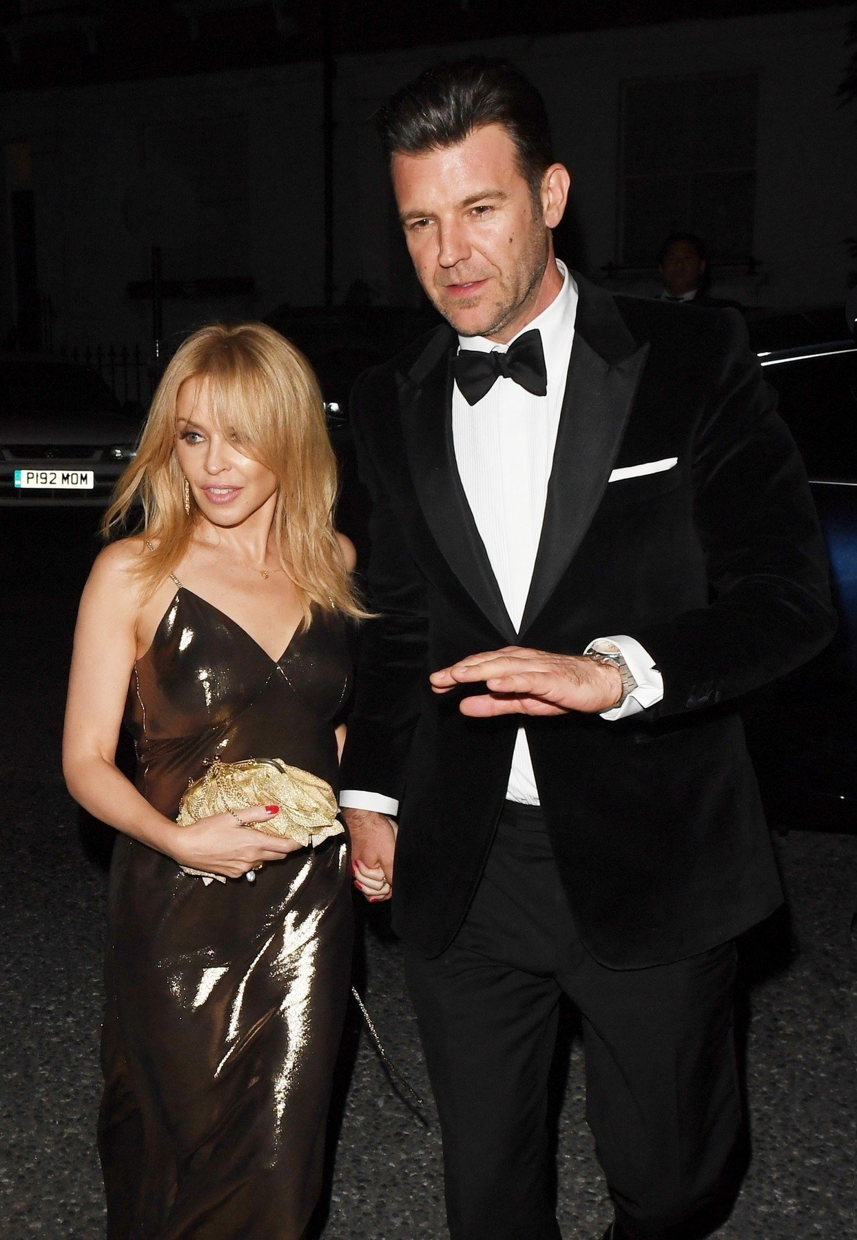 BGUK_1328081 - London, UNITED KINGDOM  - Kylie Minogue goes red carpet official with new Beau Paul Solomons at the GQ Awards in London. Kylie was seen heading to the after party at Fitzroy Yard in Primrose Hill with her new boyfriend Paul following the awards. Arriving at the party boyfriend Paul was seen with his hand placed on Kylie Minogue's chest as he helped her out of the car.  Pictured: Kylie Minogue, Paul Solomons    *UK Clients - Pictures Containing Children Please Pixelate Face Prior To Publication*, Image: 385553625, License: Rights-managed, Restrictions: , Model Release: no, Credit line: Profimedia, Backgrid UK