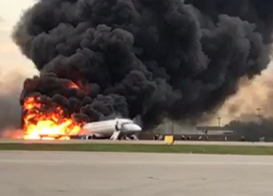 A passenger plane is seen on fire after an emergency landing at the Sheremetyevo Airport outside Moscow, Russia May 5, 2019. The Investigative Committee of Russia/Handout via REUTERS. ATTENTION EDITORS - THIS IMAGE WAS PROVIDED BY A THIRD PARTY. NO ARCHIVES. NO RESALES. MANDATORY CREDIT.