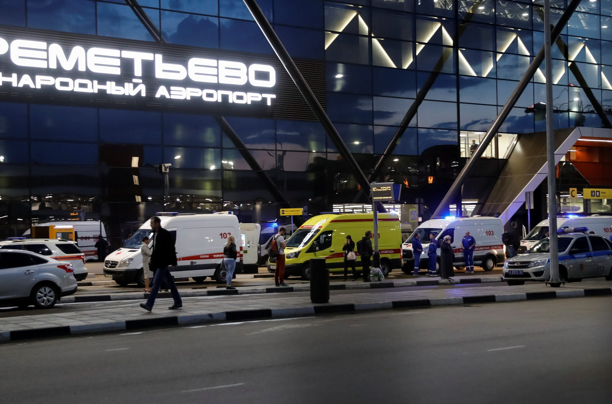 Ambulances wait in front of the terminal building after a passenger plane made an emergency landing at the Sheremetyevo Airport outside Moscow, Russia May 5, 2019. REUTERS/Tatyana Makeyeva