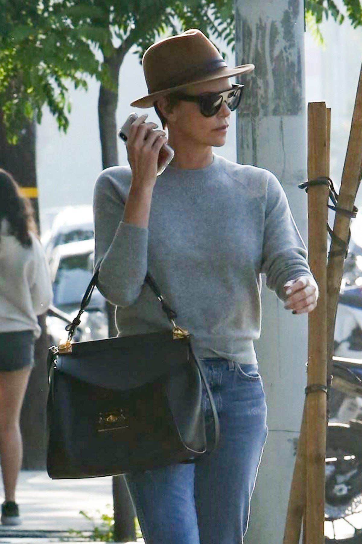 West Hollywood, CA  - *EXCLUSIVE* - Actress, Charlize Theron spends approximately 4 hours inside a West Hollywood Salon and exits with a shorter hair do! Although covered with a hat, Charlize's locks appear to have been trimmed quite short!  Pictured: Charlize Theron    *UK Clients - Pictures Containing Children Please Pixelate Face Prior To Publication*, Image: 430765049, License: Rights-managed, Restrictions: , Model Release: no, Credit line: Profimedia, Backgrid USA
