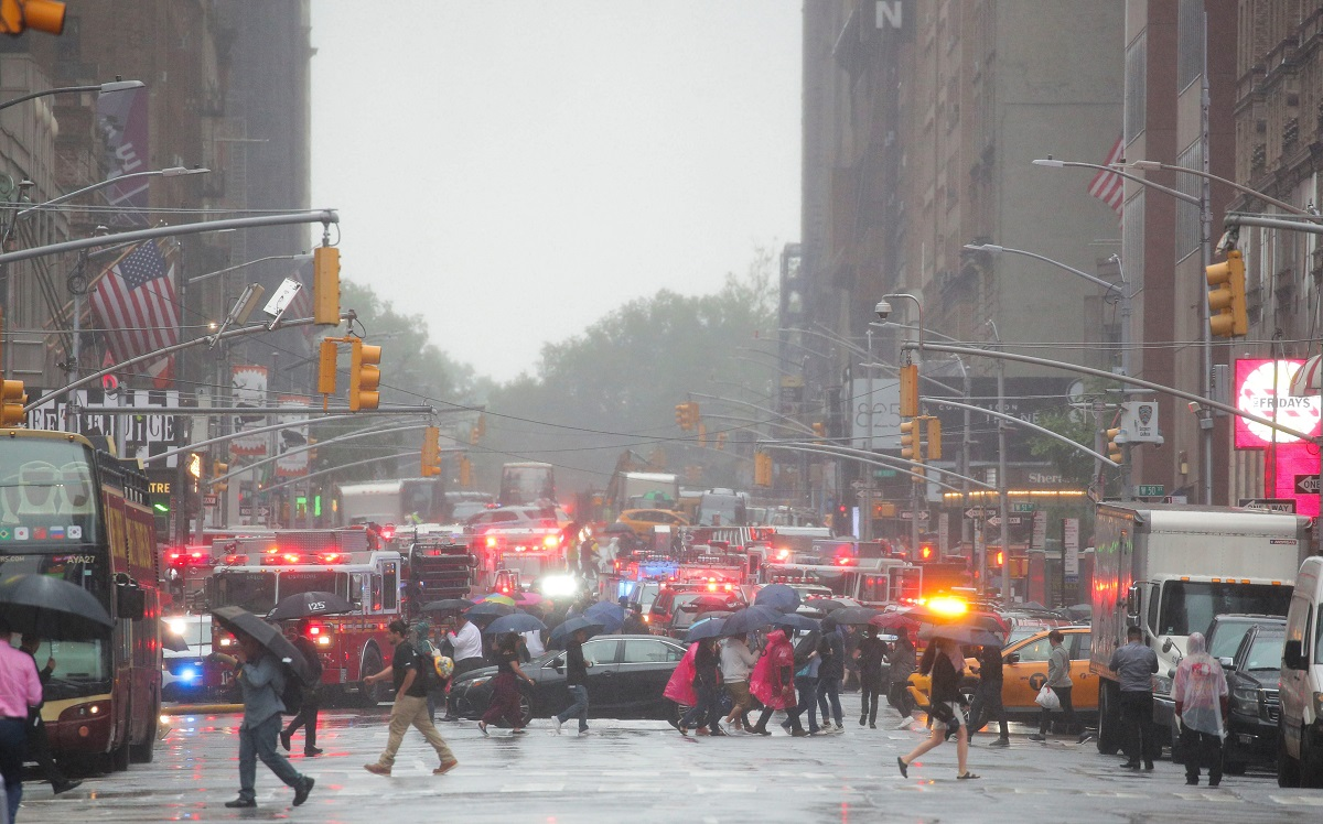 Emergency vehicles fill the street at the scene after a helicopter crashed atop a building in Times Square and caused a fire in the Manhattan borough of New York, New York, U.S., June 11, 2019. REUTERS/Brendan McDermid