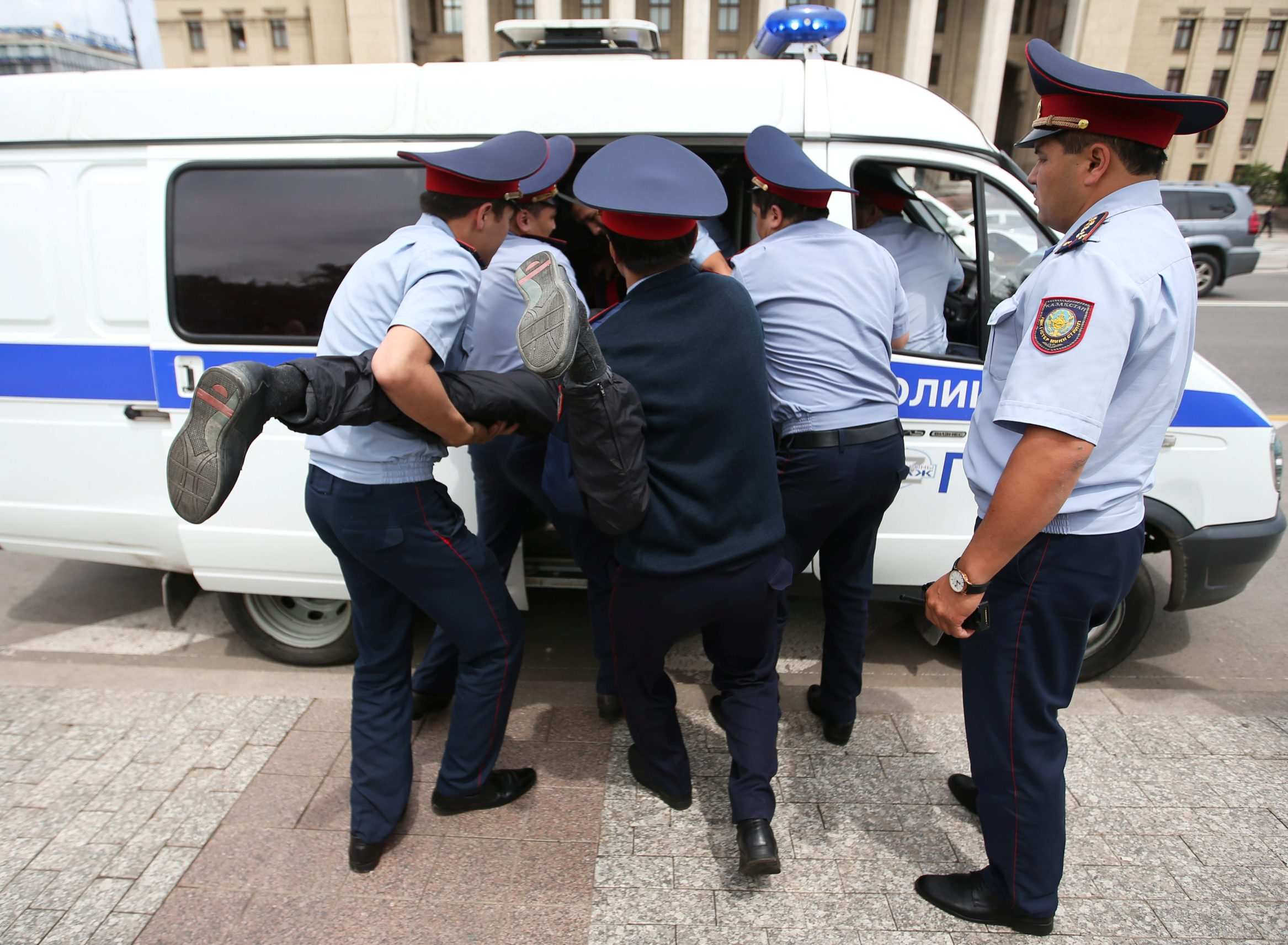 Police officers detain an opposition supporter during a protest against presidential election results, in Almaty, Kazakhstan, June 10, 2019. REUTERS/PavelMikheyev