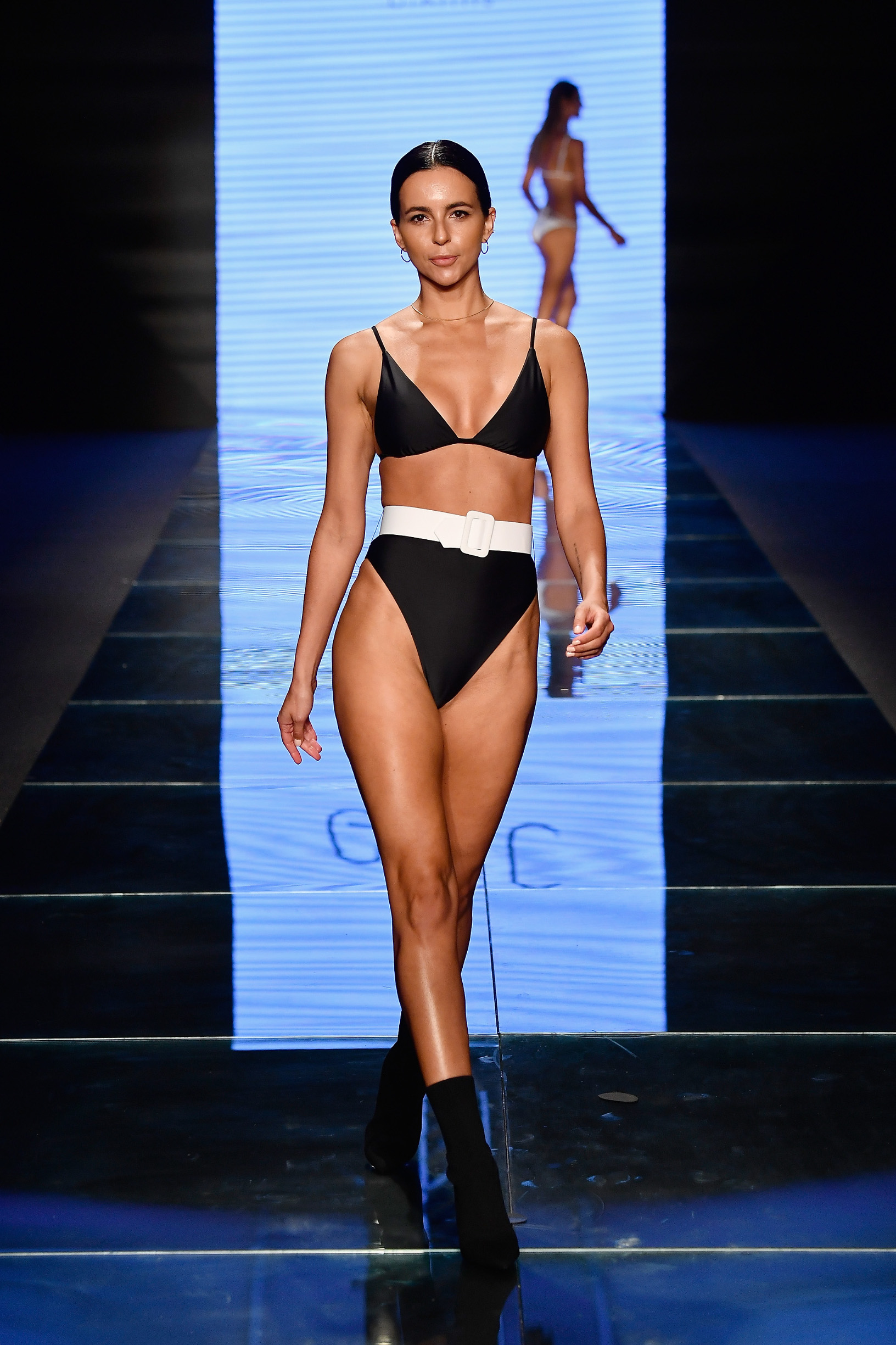 MIAMI BEACH, FL - JULY 14:  A model walks the runway for Gigi C Bikinis during the Paraiso Fashion Fair at The Paraiso Tent on July 14, 2018 in Miami Beach, Florida.  (Photo by Frazer Harrison/Getty Images for Gigi C Bikinis )